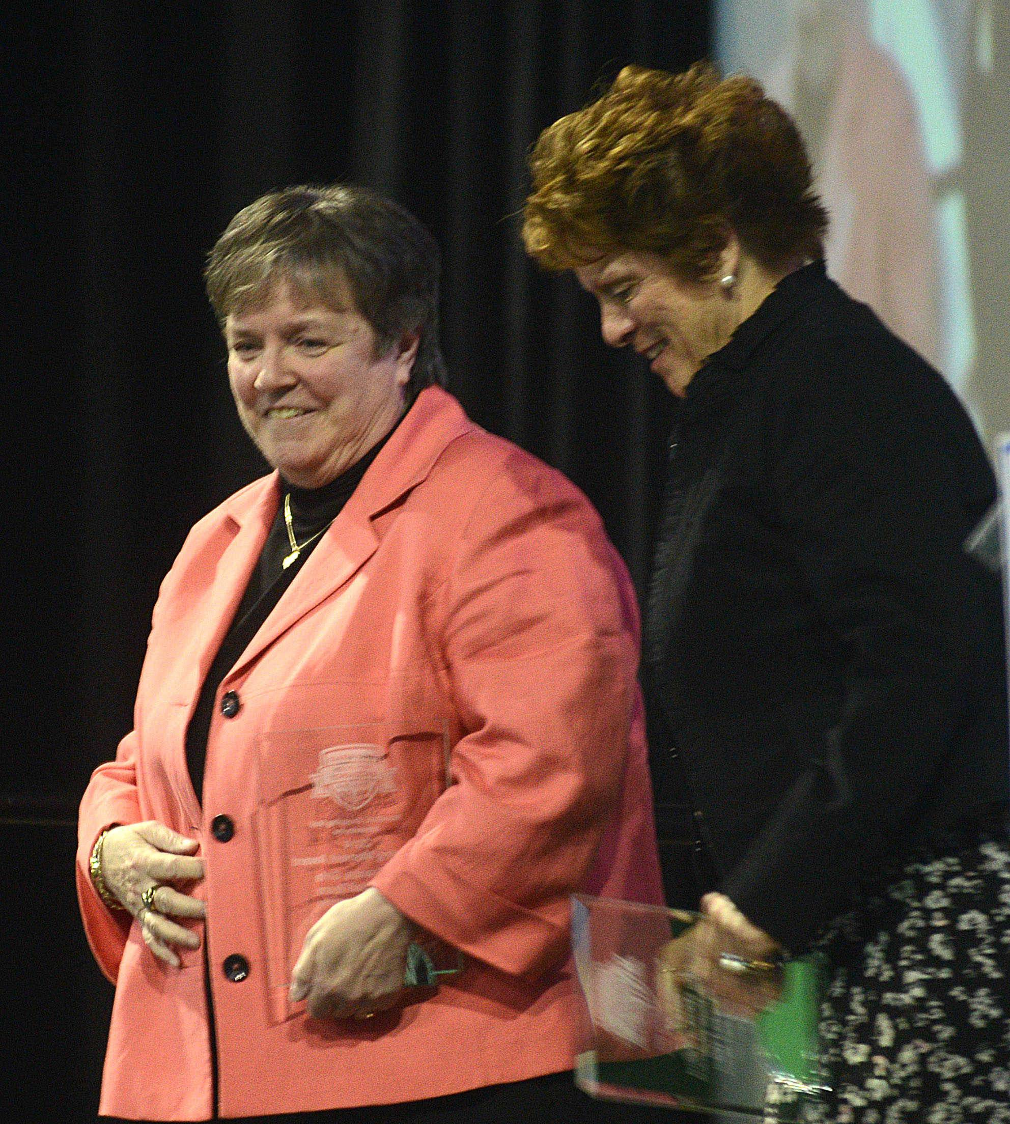 Girls volleyball coaches Jean Field, left, of IC Catholic Prep and Peg Kopec of St. Francis receive their Dazzling moment Awards during the Daily Herald Prep Sports Excellence event at the Sears Centre in Hoffman Estates on Sunday afternoon. Both coaches led their teams to state titles last autumn.
