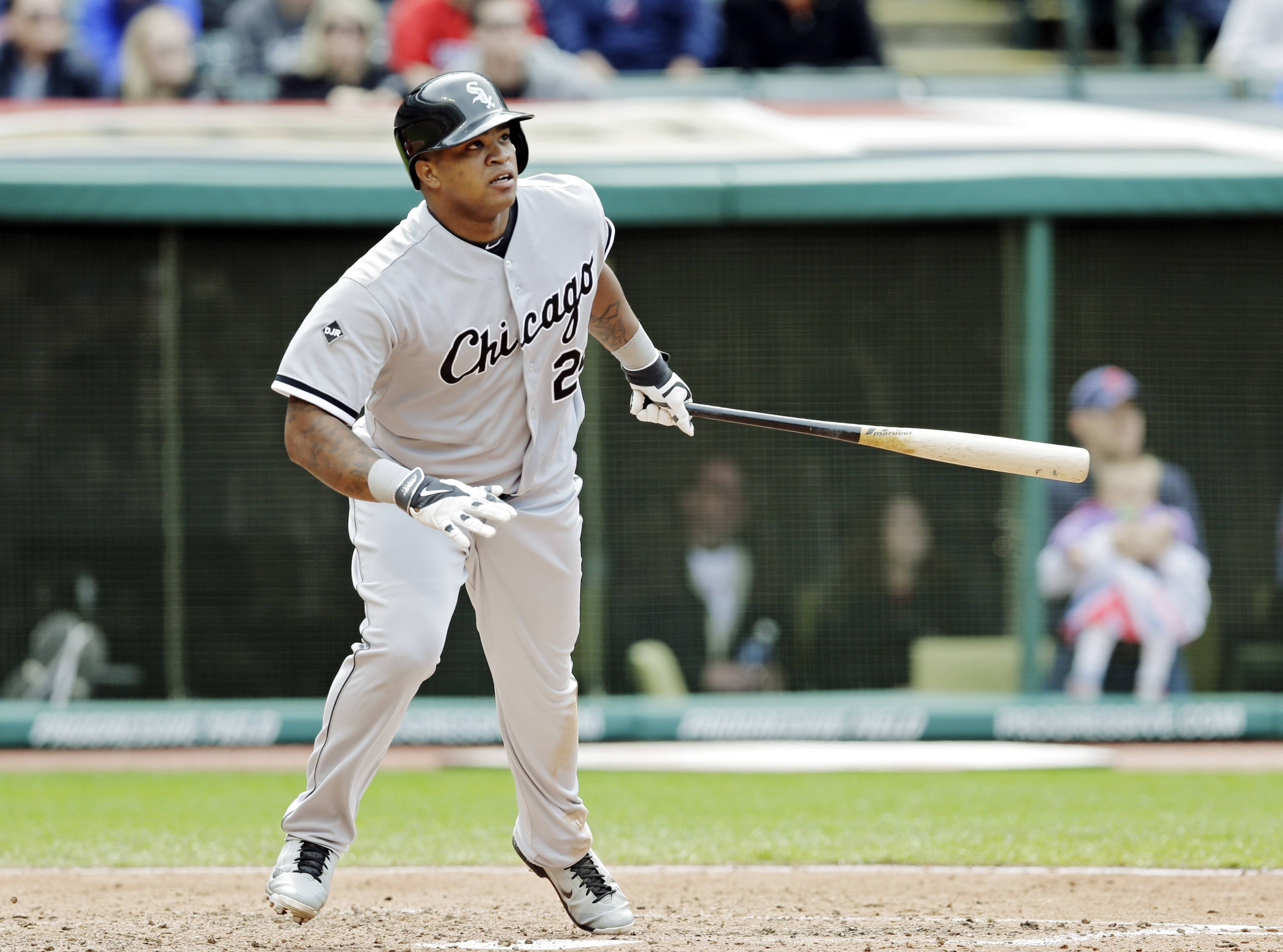 White Sox slugger Dayan Viciedo watches his three-run home run off Cleveland Indians relief pitcher John Axford in the ninth inning of a baseball game Sunday, May 4, 2014, in Cleveland. Viciedo's homer gave the White sox a 4-3 win.