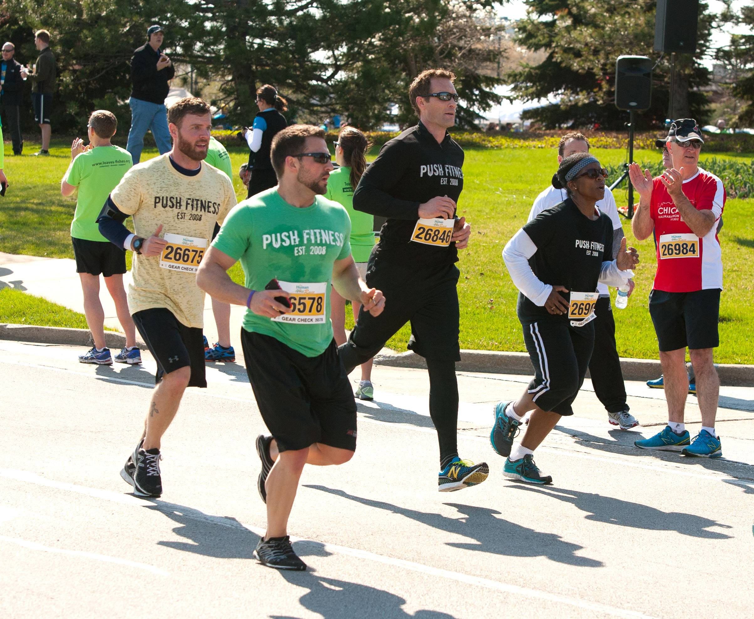 Joshua Steckler and Lisa Townsel, in black T-shirts, ran side-by-side the whole race.