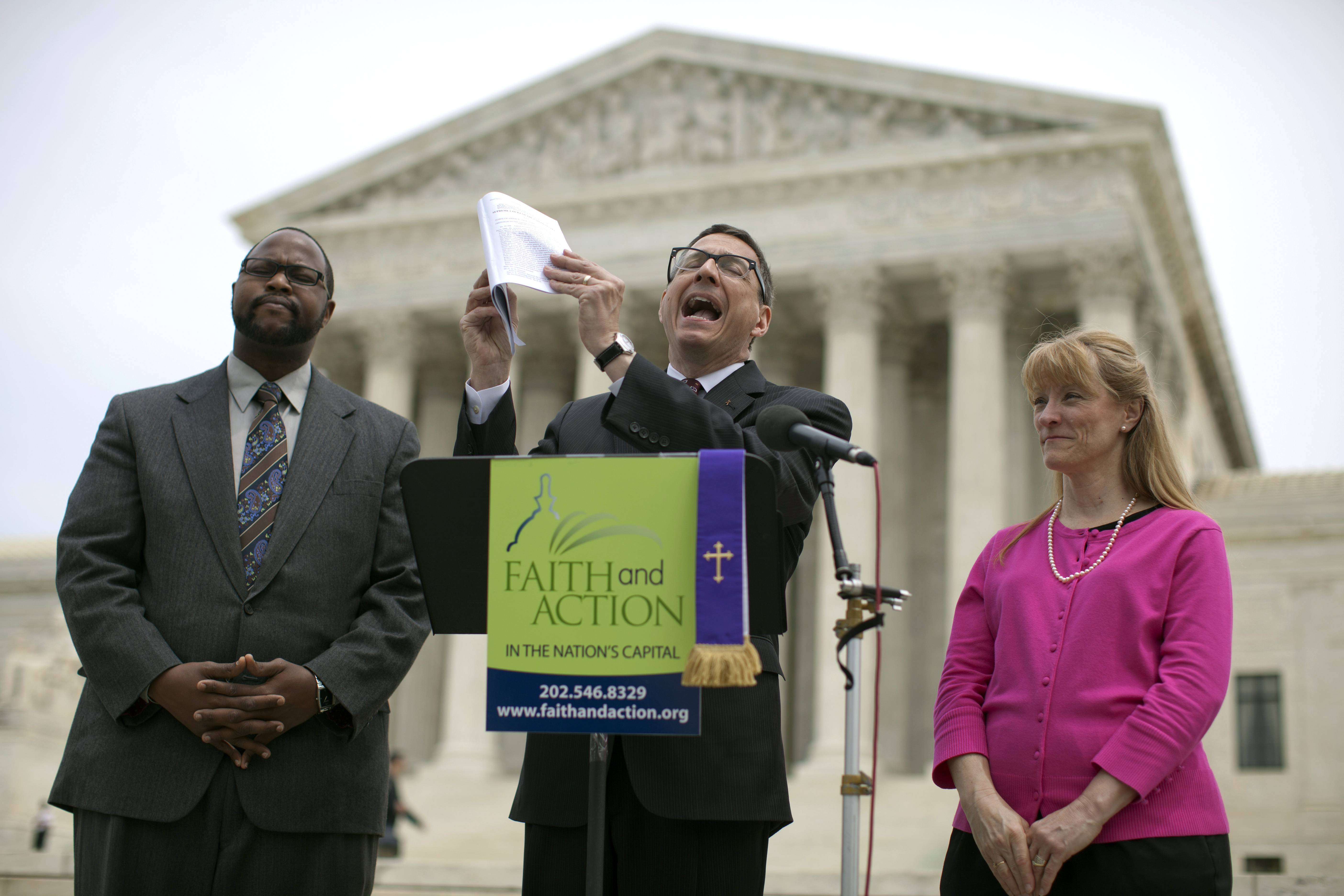 The Rev. Dr. Rob Schenck, of Faith and Action, center, speaks in front of the Supreme Court with Raymond Moore, left, and Patty Bills, both also of Faith and Action, during a news conference Monday in favor of the ruling by the court's conservative majority. A narrowly divided Supreme Court upheld decidedly Christian prayers at the start of local council meetings on Monday, declaring them in line with long national traditions though the country has grown more religiously diverse.
