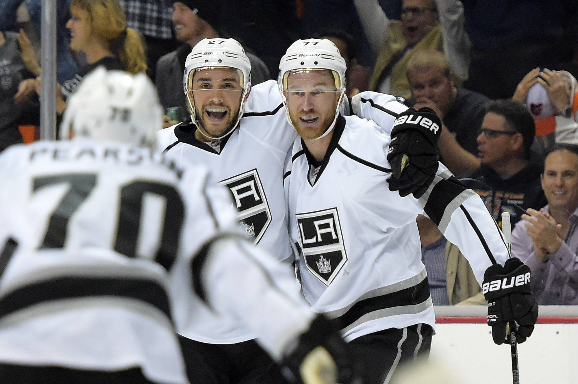 Los Angeles Kings defenseman Alec Martinez, center, celebrates his goal with left wing Tanner Pearson, left, and center Jeff Carter, right, during the first period in Game 2 of an NHL hockey second-round Stanley Cup playoff series against the Anaheim Ducks, Monday, May 5, 2014, in Anaheim, Calif.