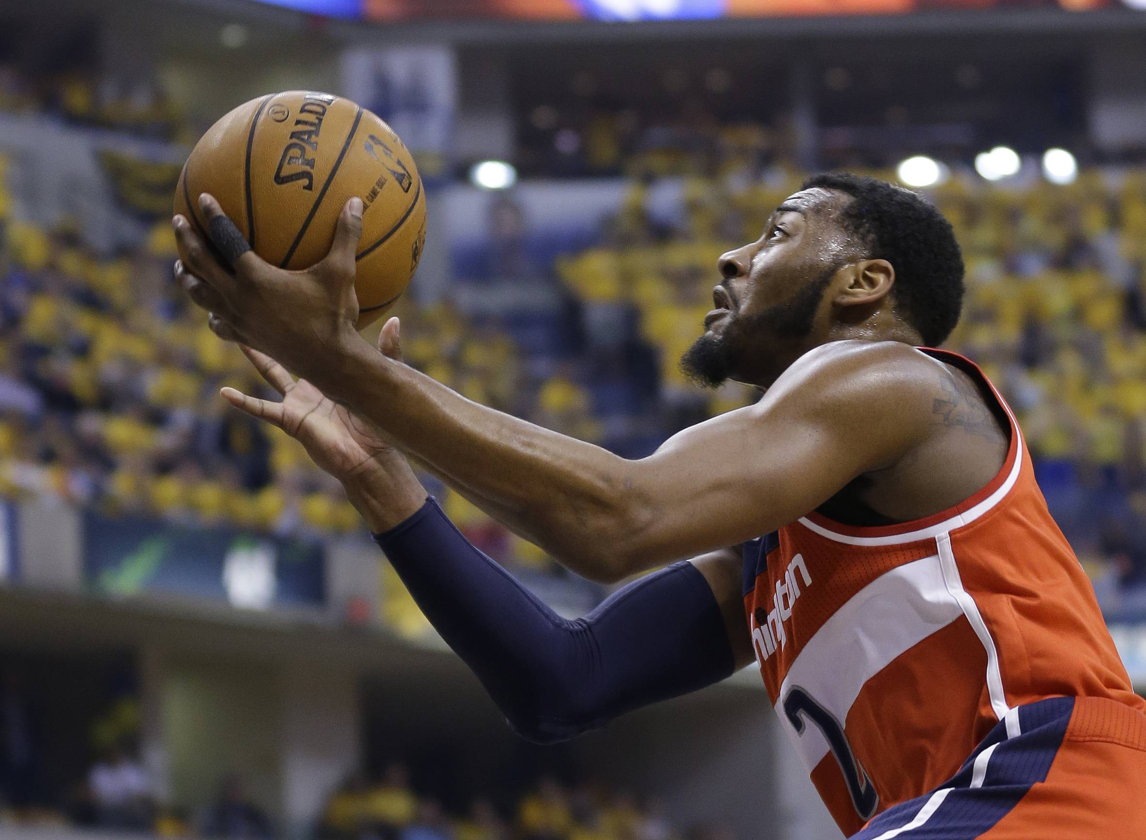 Washington Wizards' John Wall (2) puts up a shot during the first quarter of game 1 of the Eastern Conference semifinal NBA basketball playoff series against the Indiana Pacers in Indianapolis, Monday, May 5, 2014.
