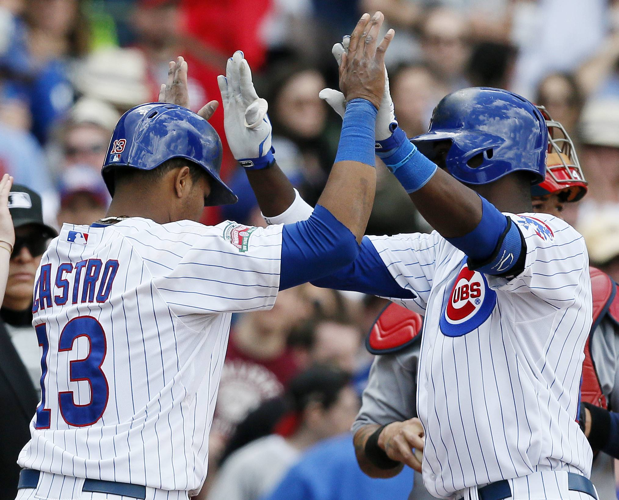 After hitting a two-run home run, Chicago Cubs' Junior Lake, right, celebrates with Starlin Castro, left, who scored, during the sixth inning of a baseball game against the St. Louis Cardinals on Saturday, May 3, 2014, in Chicago. (AP Photo/Andrew A. Nelles)