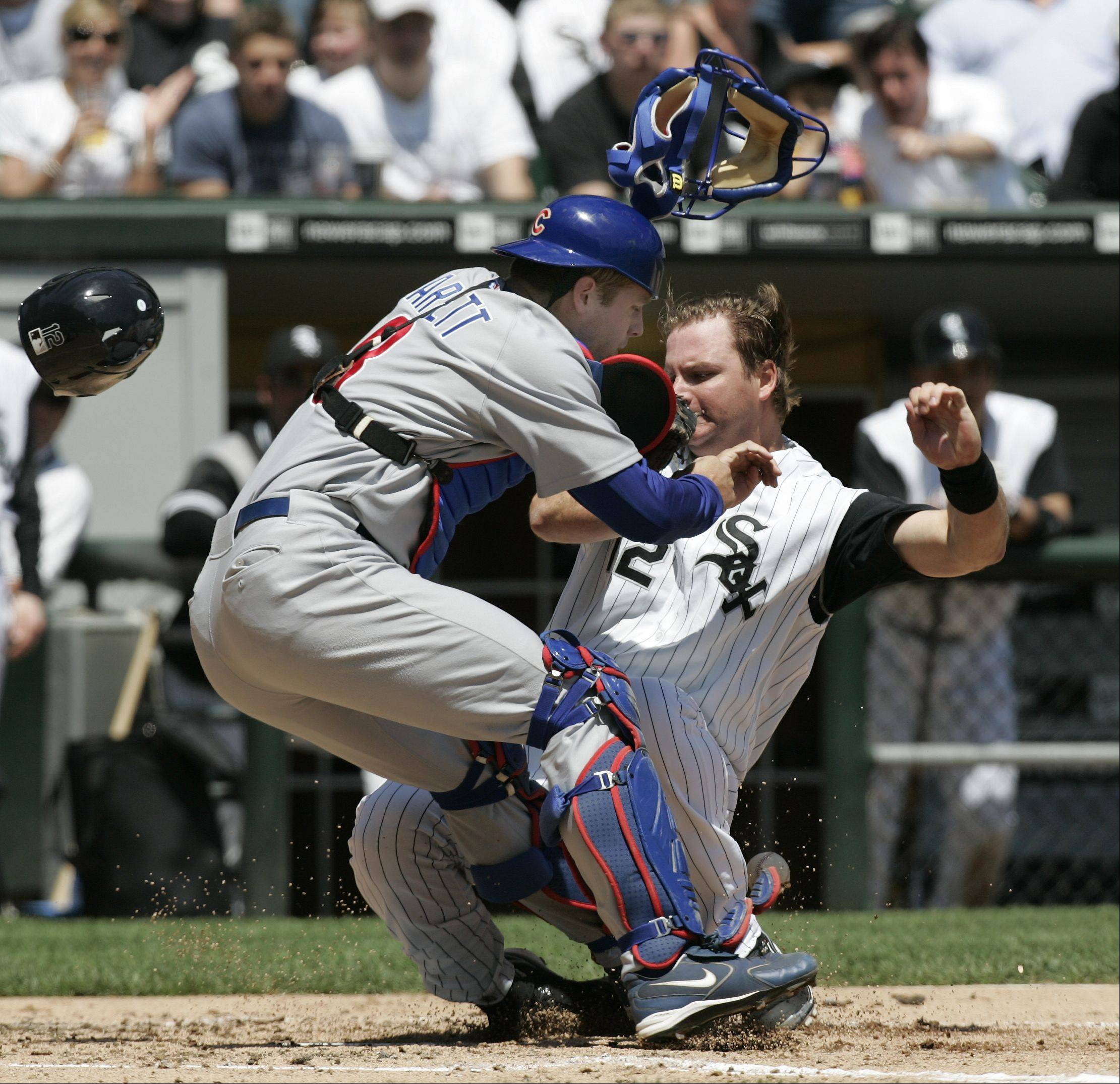 Sox A.J. Pierzynski collides with Cubs Catcher Michael Barrett in the 2nd inning, Game Two Chicago White Sox Vs Chicago Cubs at U.S. Cellular Field in Chicago. May 20, 2006.
