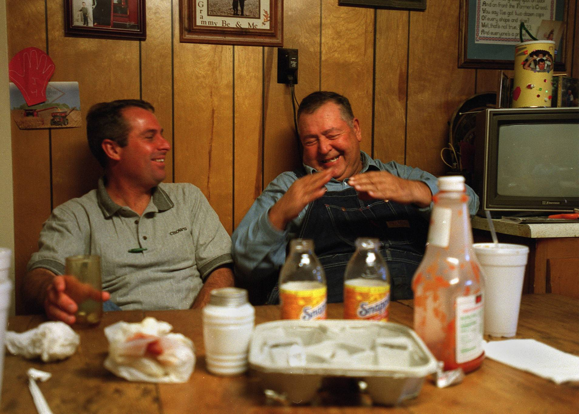 Chuck Swanson shares a laugh with family friend Randy Pauli over a lunch at the family farmhouse in Gilberts. I had the privilege of photographing members of the Swanson family on several occasions. Of all the farmers I came across in my years as a photojournalist, Chuck was one of the best. When he passed in 2008, I was touched to hear from his wife Beulah after a picture that I shot of him on his tractor was used on the cover of his memorial program.