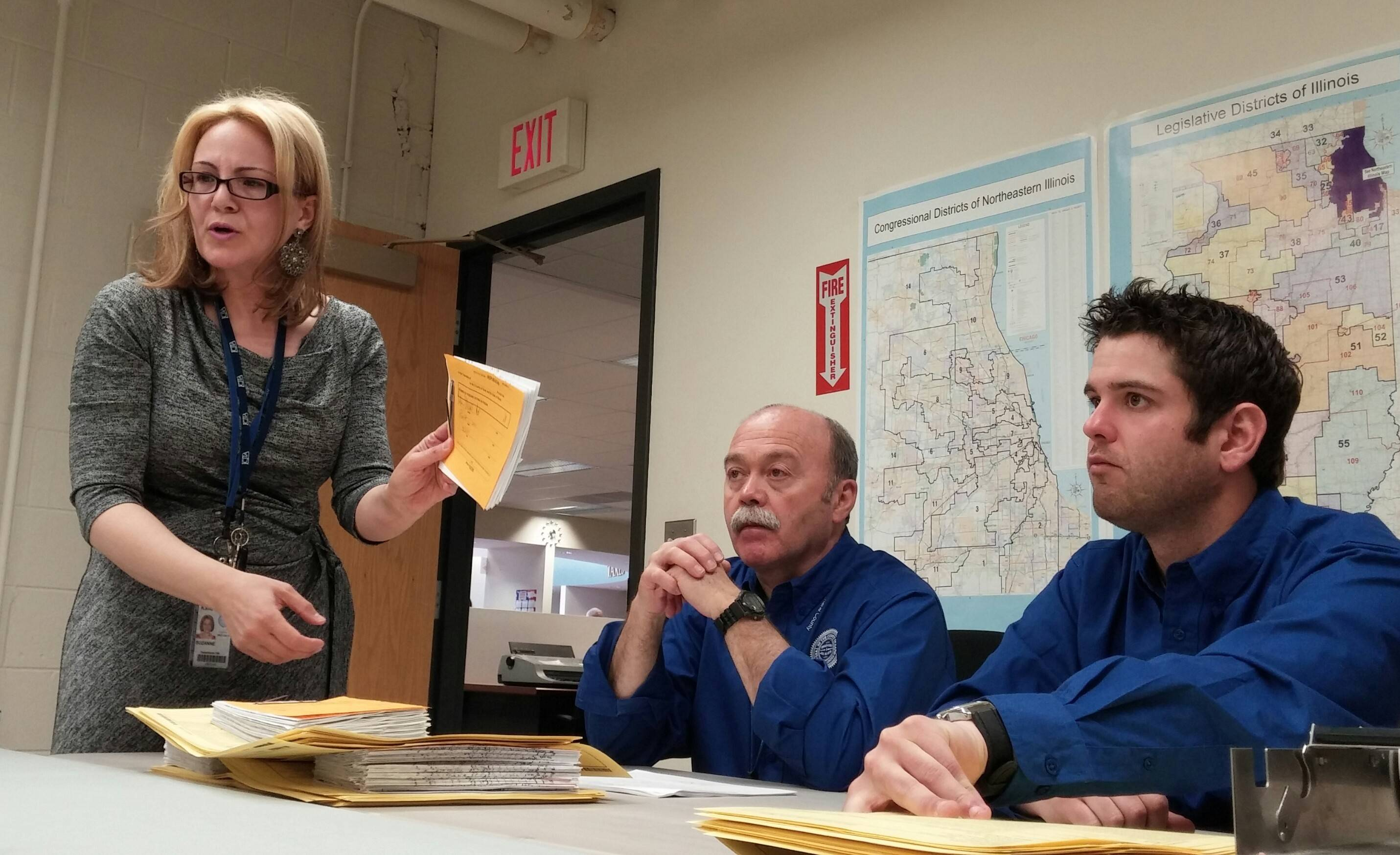 Kane County Director of Elections Suzanne Fahnestock explains a procedure during Monday's discovery recount of 16 precincts in the race between D.J. Tegeler and Marmarie Kostelny for the GOP nomination for Kane County Circuit judge.