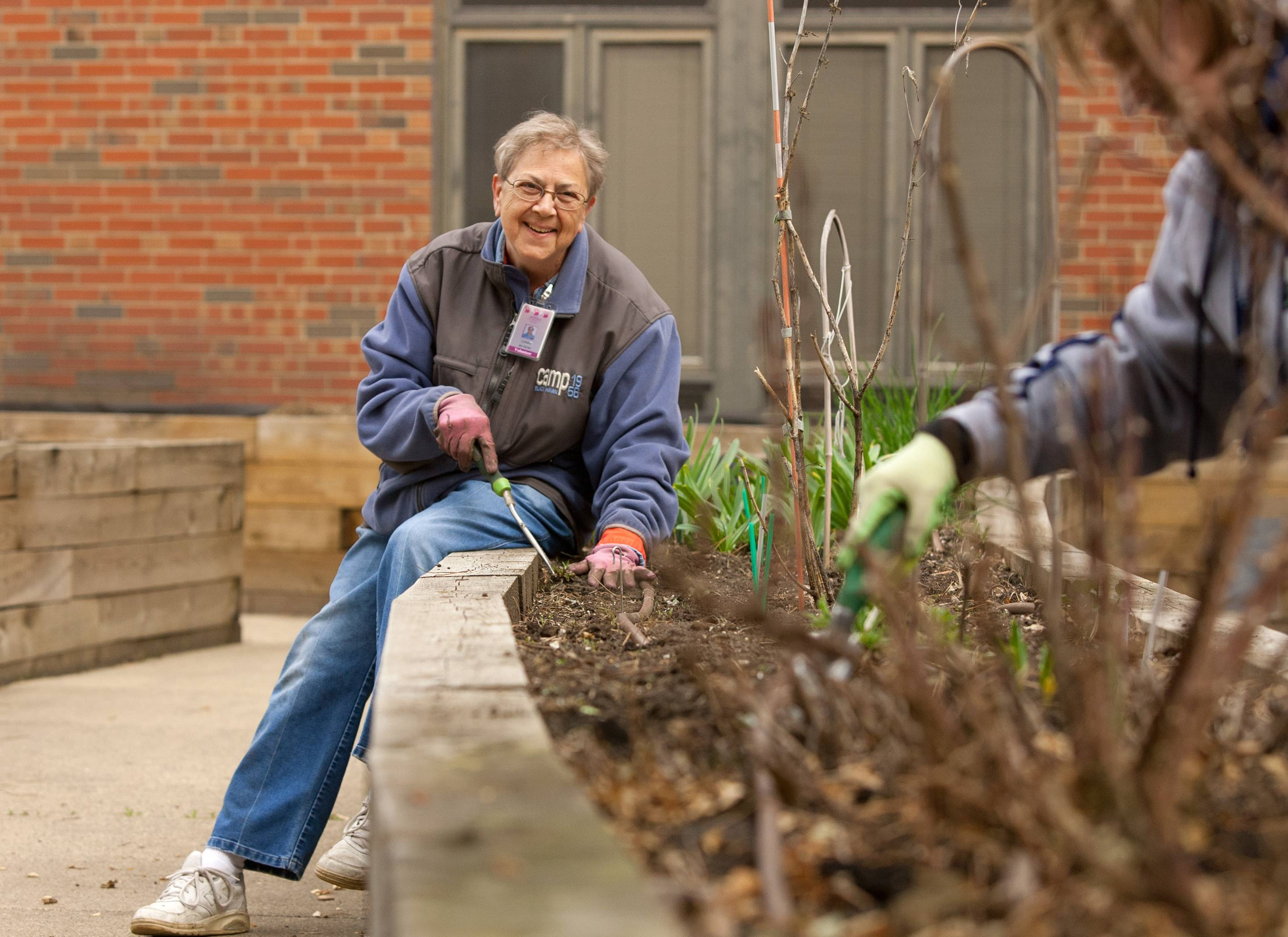 Linda Kunesh of Carol Stream, along with other University of Illinois master gardeners, prepare garden beds at the DuPage Convalescent Center.