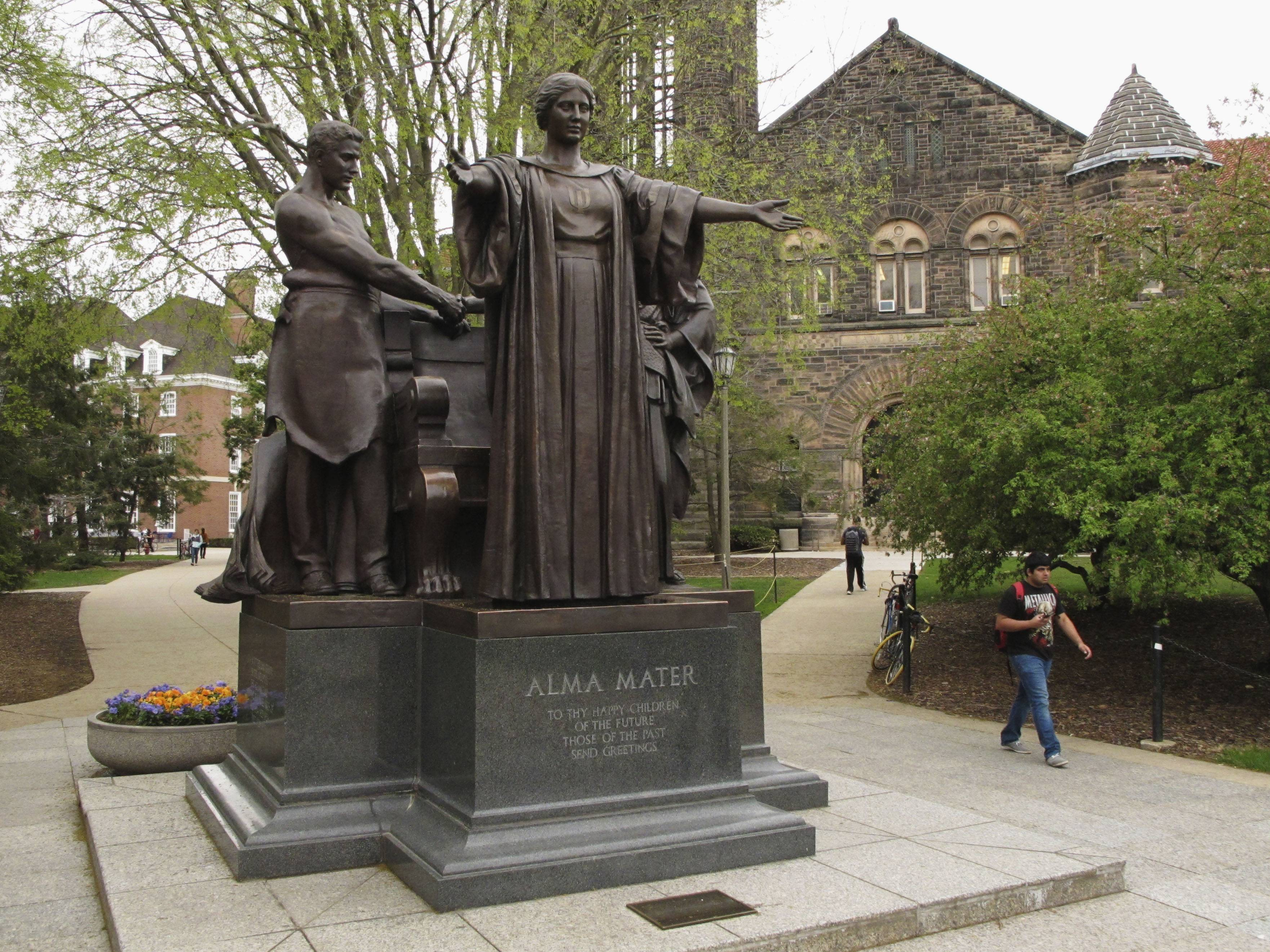 Students walk past the Alma Mater statue, a landmark on the University of Illinois campus in Urbana. Public universities in Illinois are bracing for waves or retirements because a state pension-reform law will sharply cut their retirement funds.