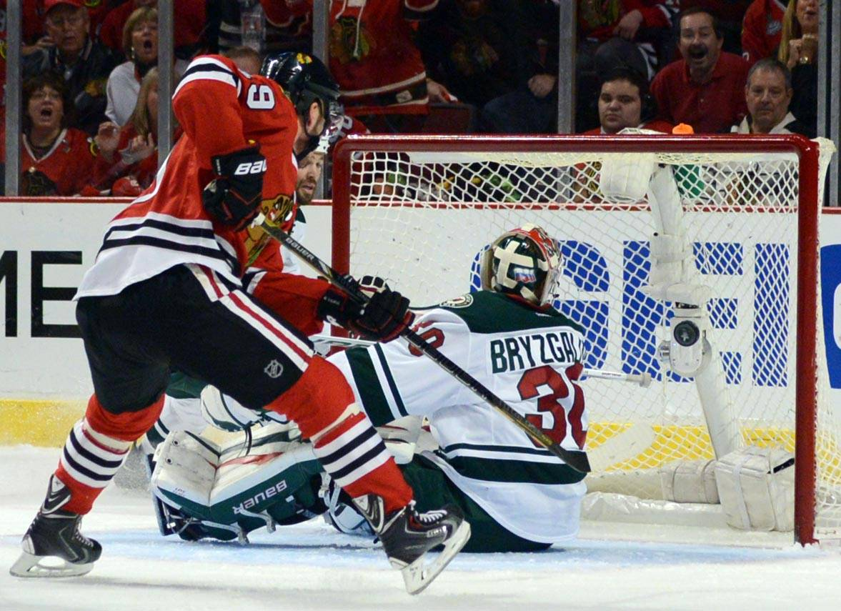 Chicago Blackhawks center Jonathan Toews scores the first goal of the game in the first period against the Minnesota Wild Sunday in Game 2 of the second round of the Stanley Cup Playoffs at the United Center in Chicago. The Hawks are up 2-0 in the series.