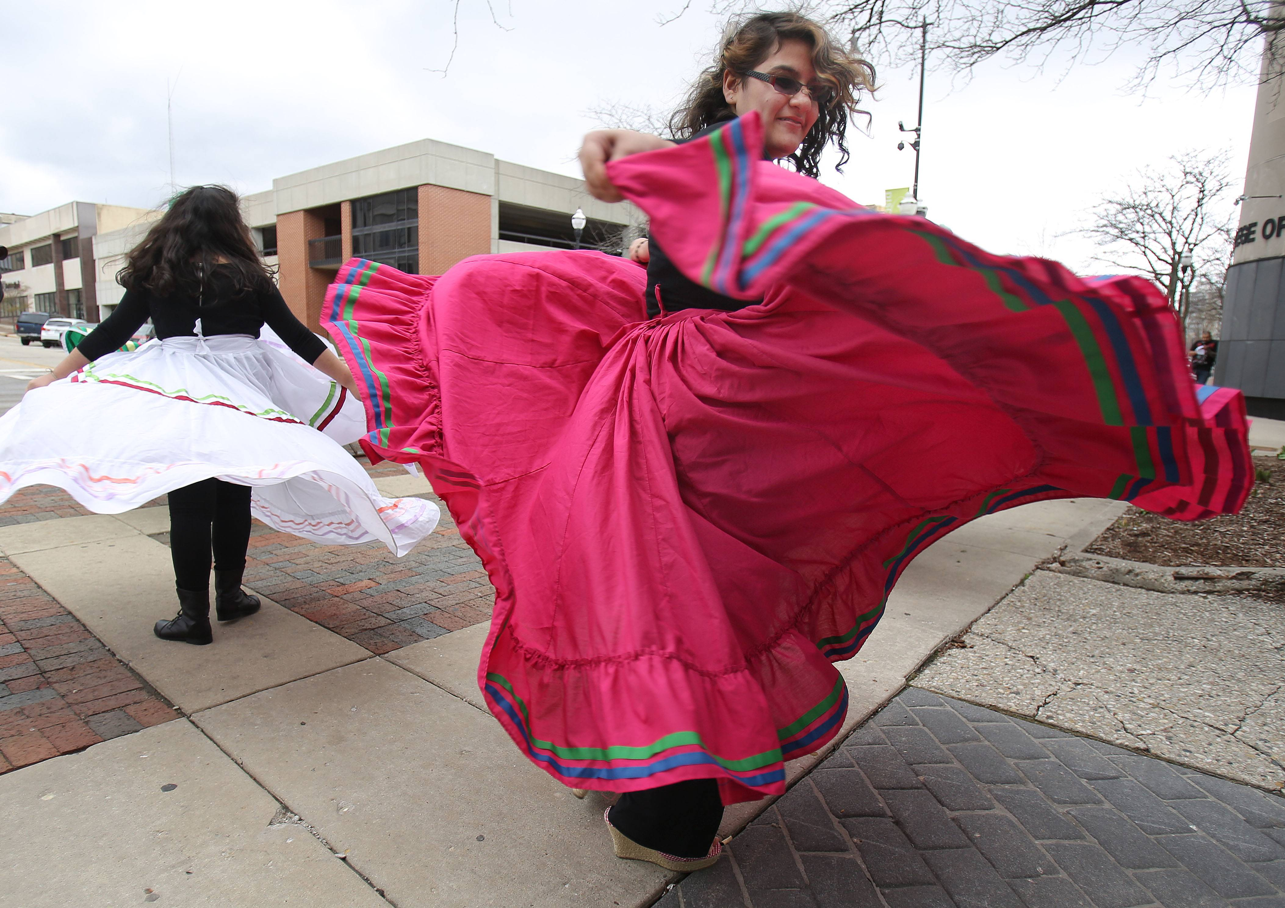 Maria Garcia, 13, of Waukegan, and members of the Abbott Middle School folkloric dancers, perform during a Cinco de Mayo celebration on Thursday at the College of Lake County's Lakeshore Campus.