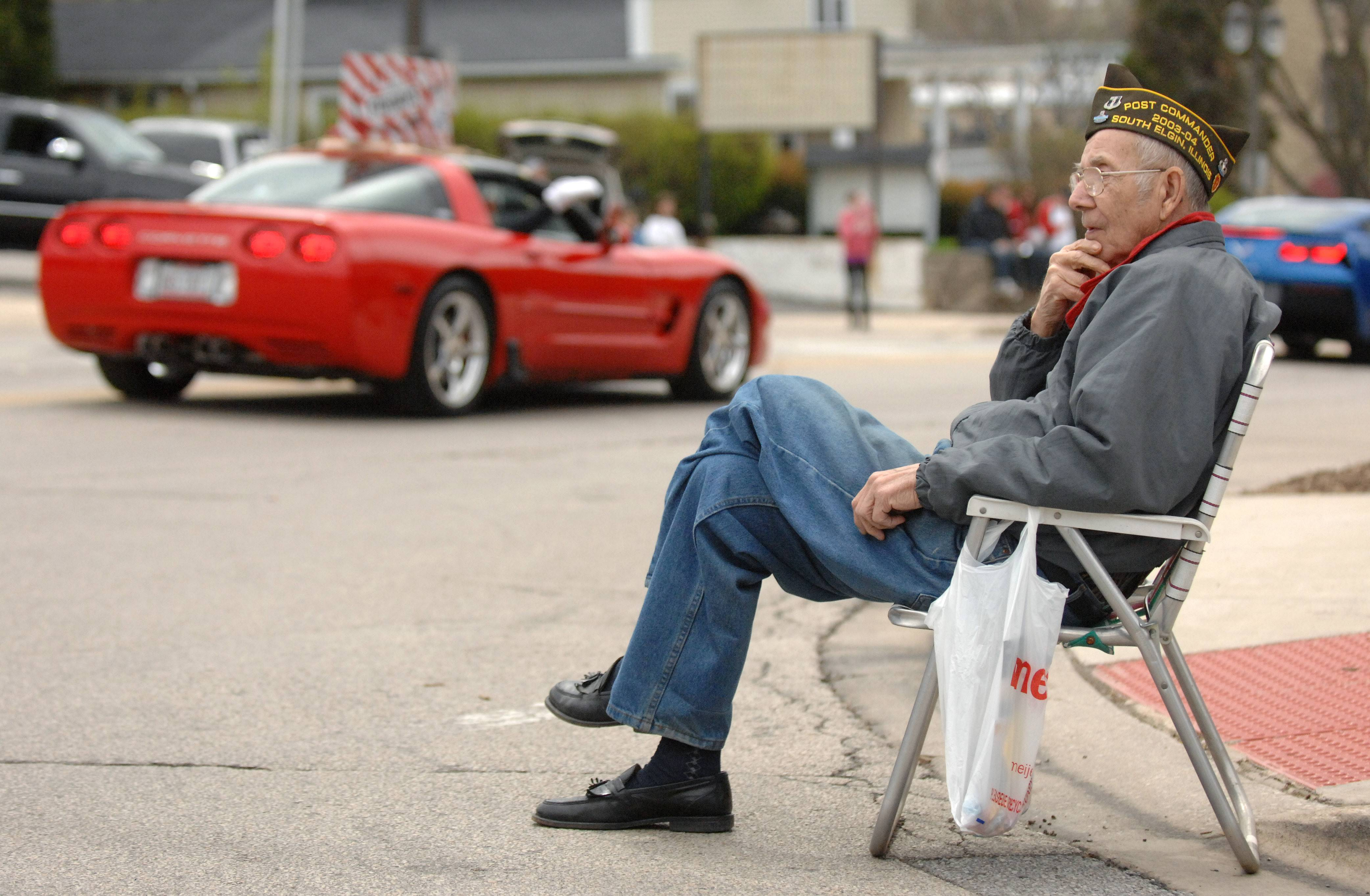 Army veteran of the Korean war, Arnold Bochum, of Elgin, watches the 40th annual Loyalty Day parade in Batavia on Sunday. He has sat at this spot, at the corner of Route 25 and Wilson, for the past 10 years to watch the parade. Bochum served from 1954-56 and served in the Korean War and Germany. He was collecting candy for a neighbor's child.