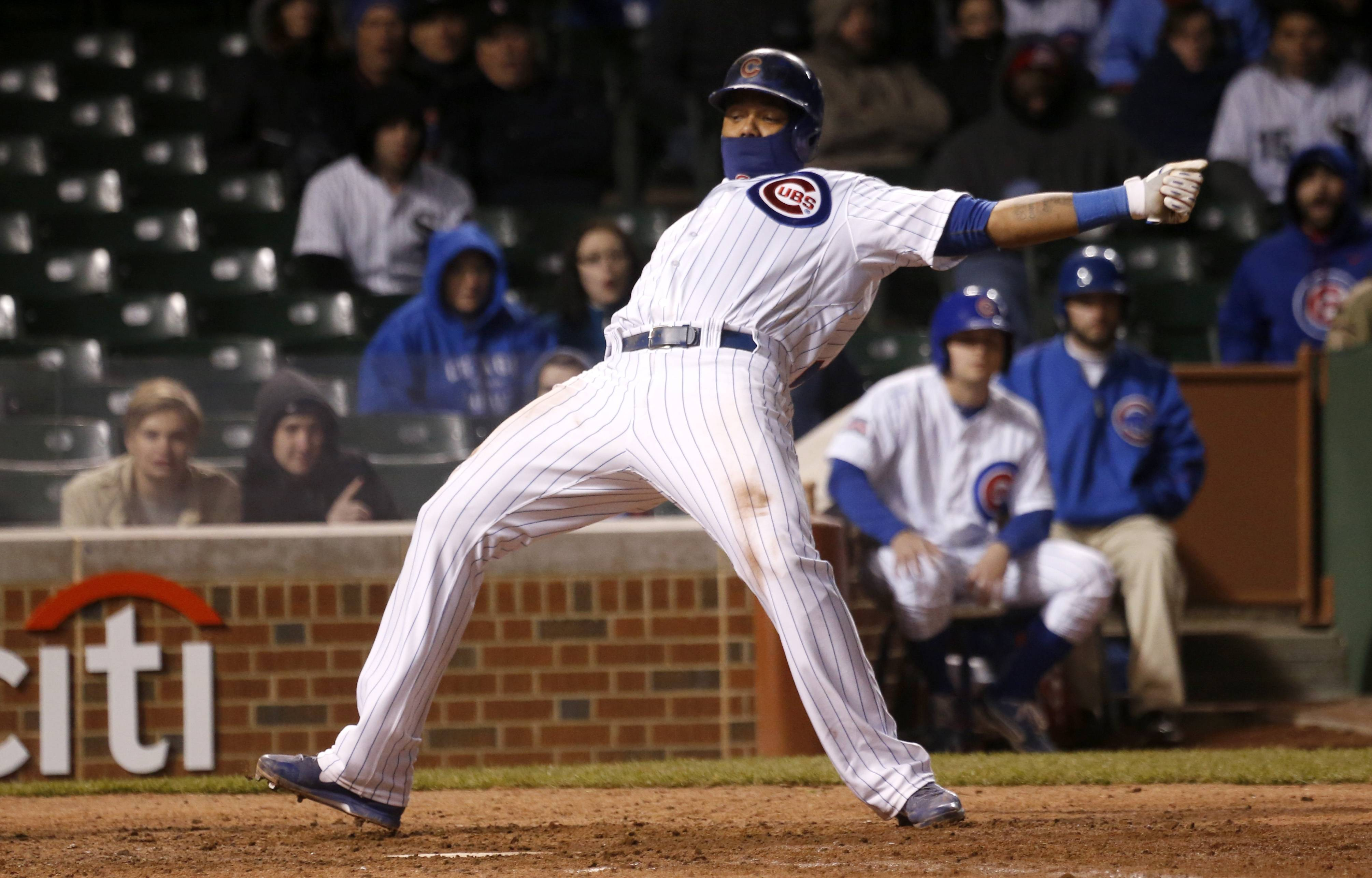 The Cubs' Starlin Castro is brushed back from the plate by a pitch from White Sox relief pitcher Daniel Webb during the 11th inning Monday night.