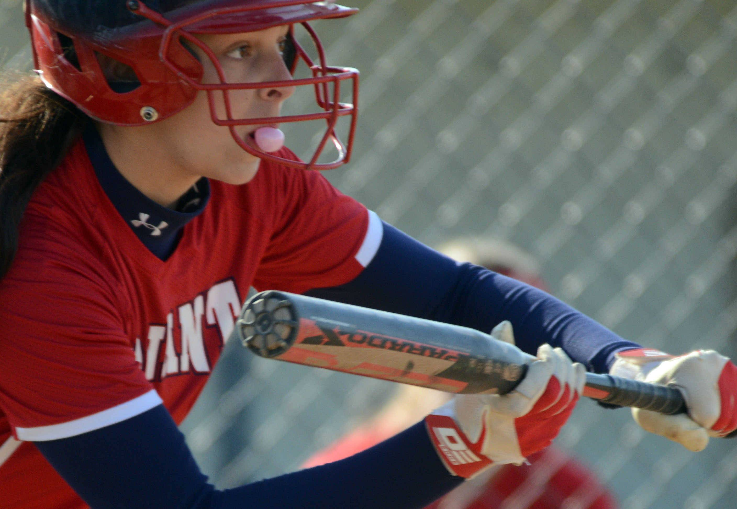 Conant's DeeDee Durr makes a bubble as she shows bunt against Prospect on Monday.