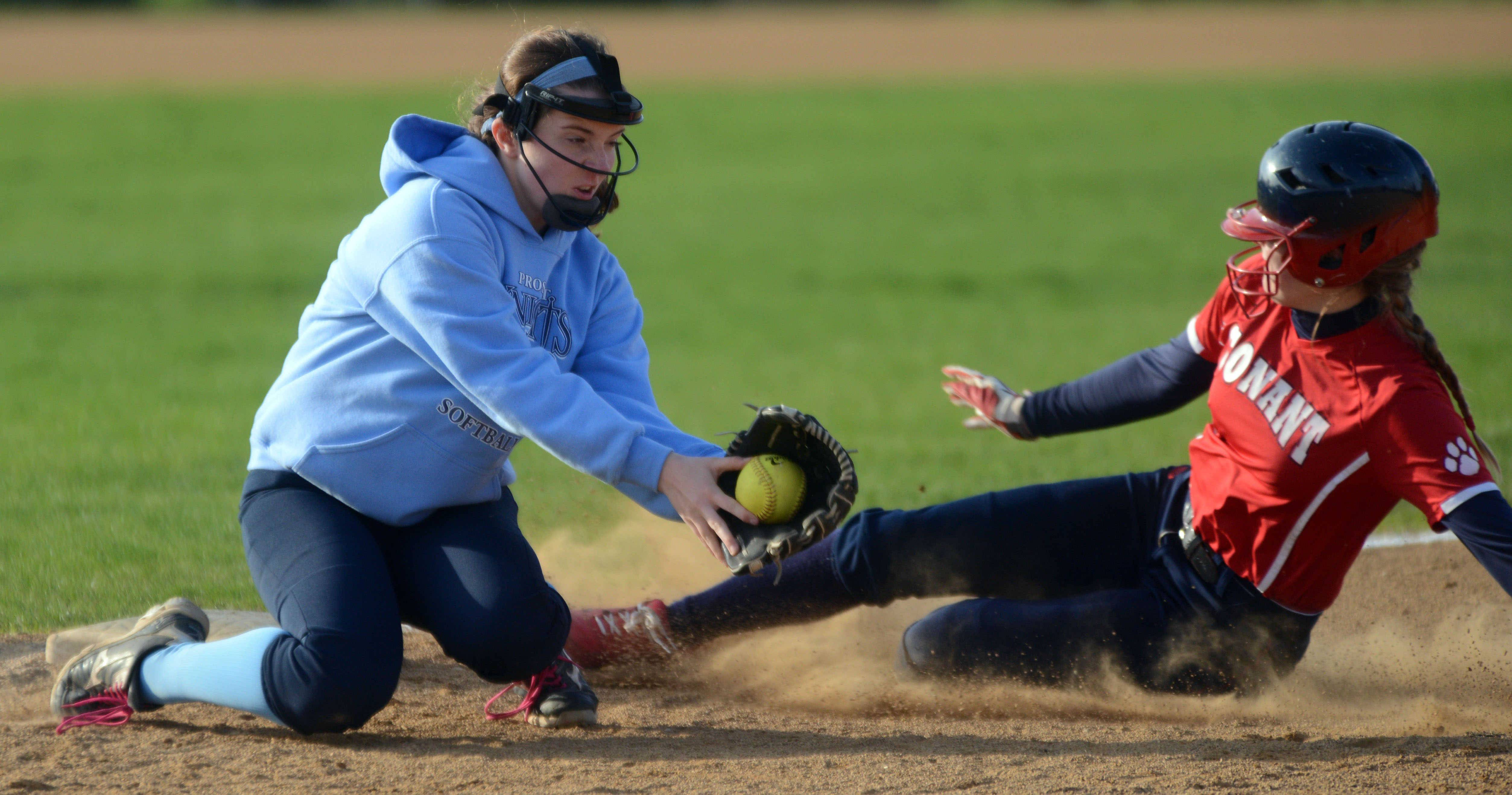 Conant's Sara Neuman, right, is safe at third base ahead of the tag by Prospect's Cate Meersman on Monday night.