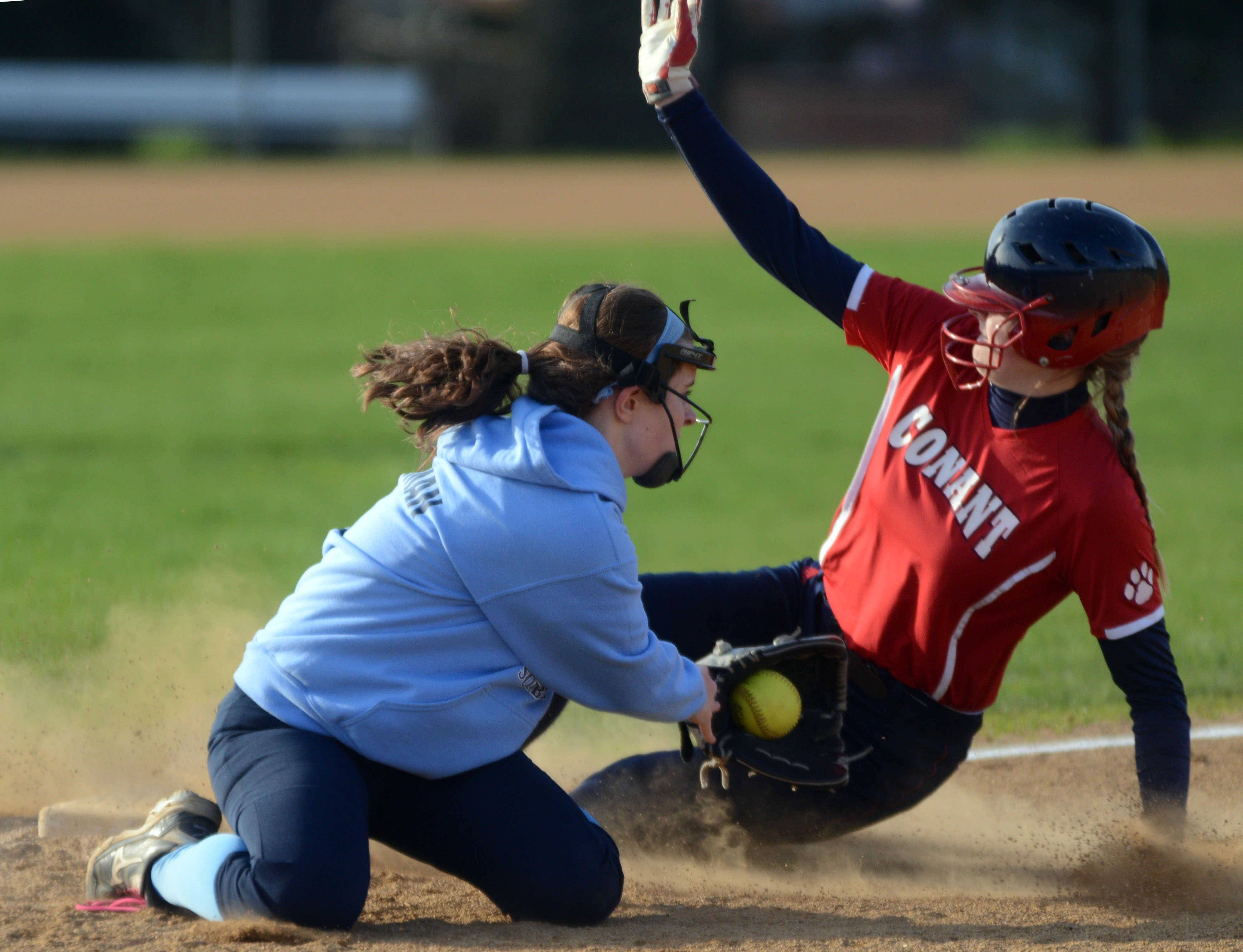 Conant's Sara Neuman, right, is safe at third base ahead of the tag by Prospect's Cate Meersman on Monday.