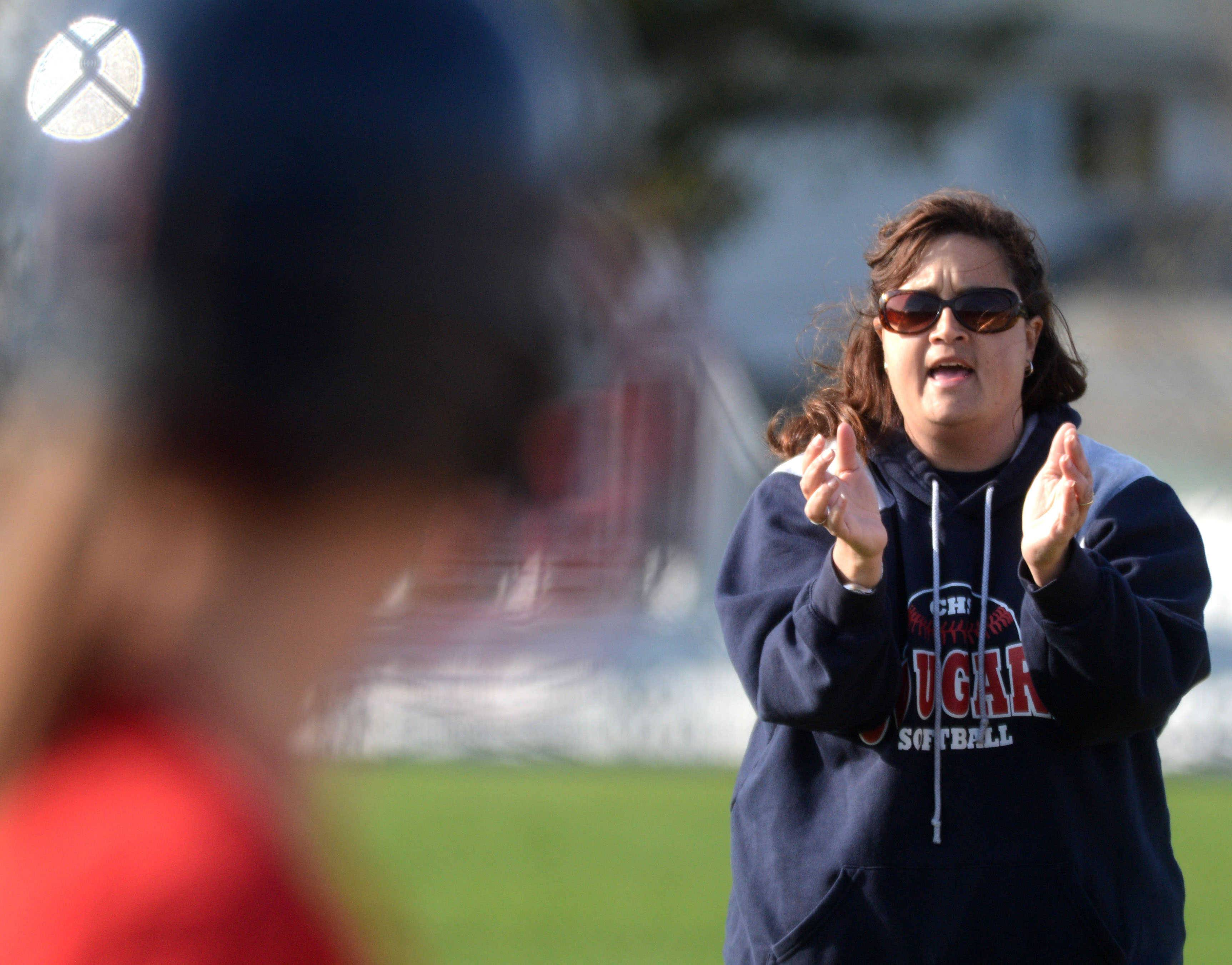 Conant coach CathyAnn Smith offers encouragement from the third base coaching box against visiting Prospect on Monday.
