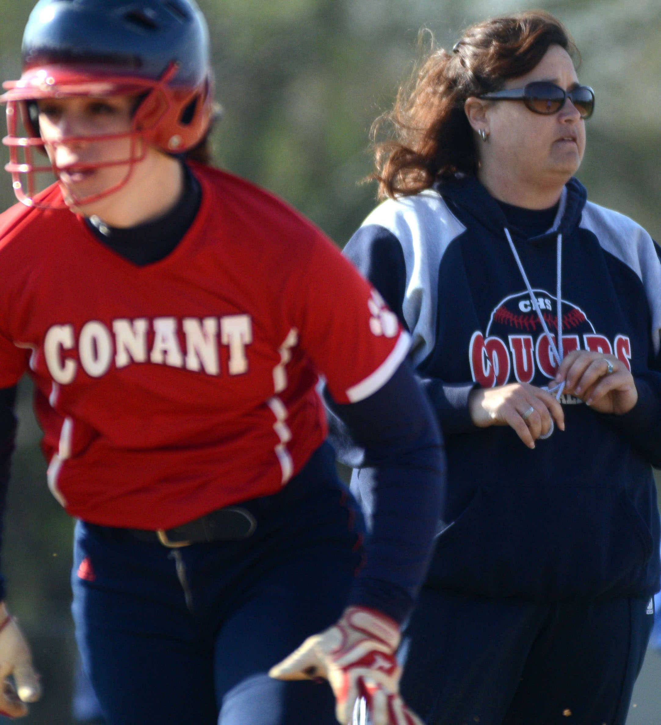 Conant coach CathyAnn Smith keeps an eye on the action from the third base coaching box against visiting Prospect on Monday.