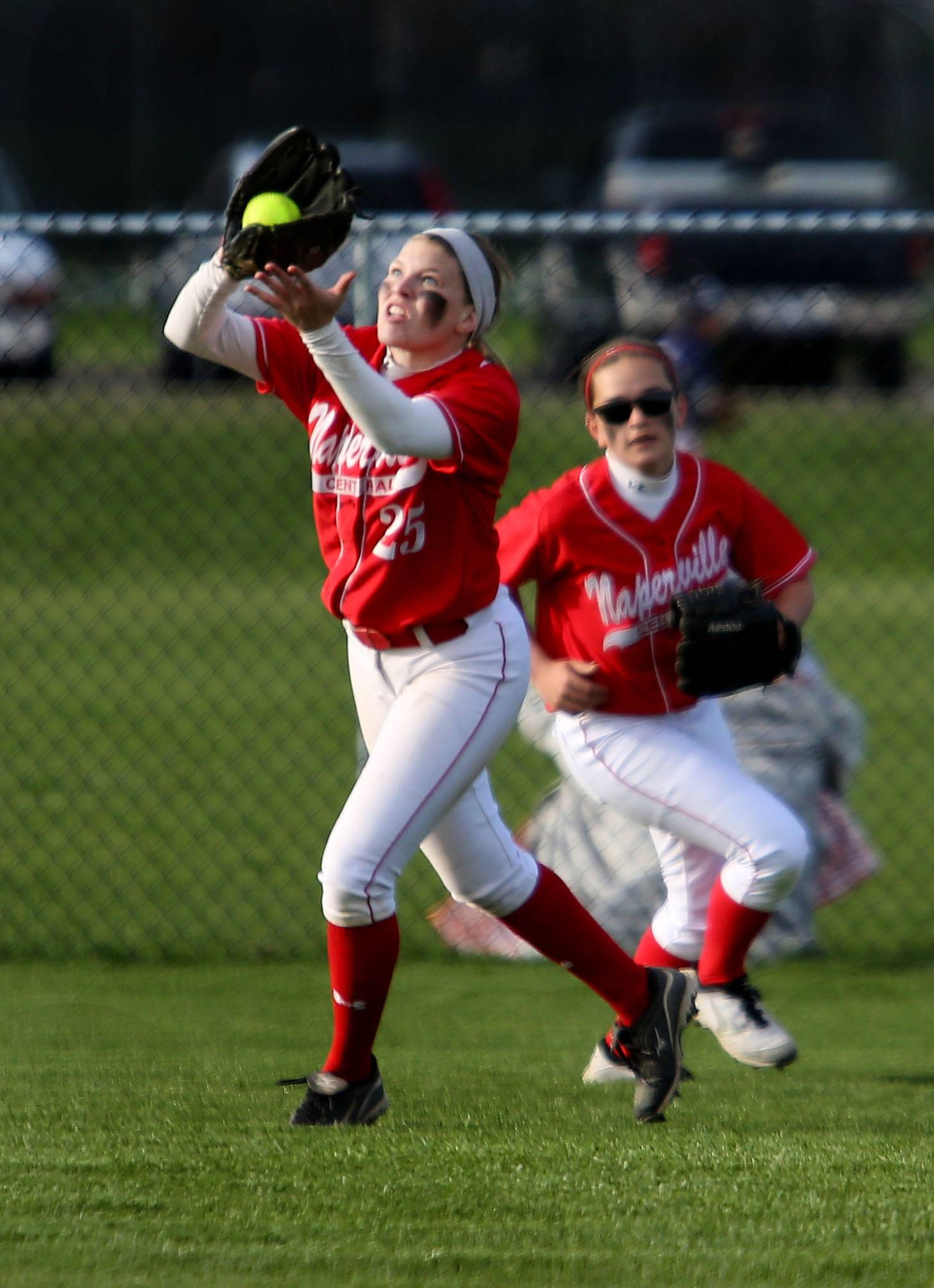 Naperville Central's Maddi Doane makes a catch in the outfield for an out against Naperville North during softball action on Monday in Naperville.