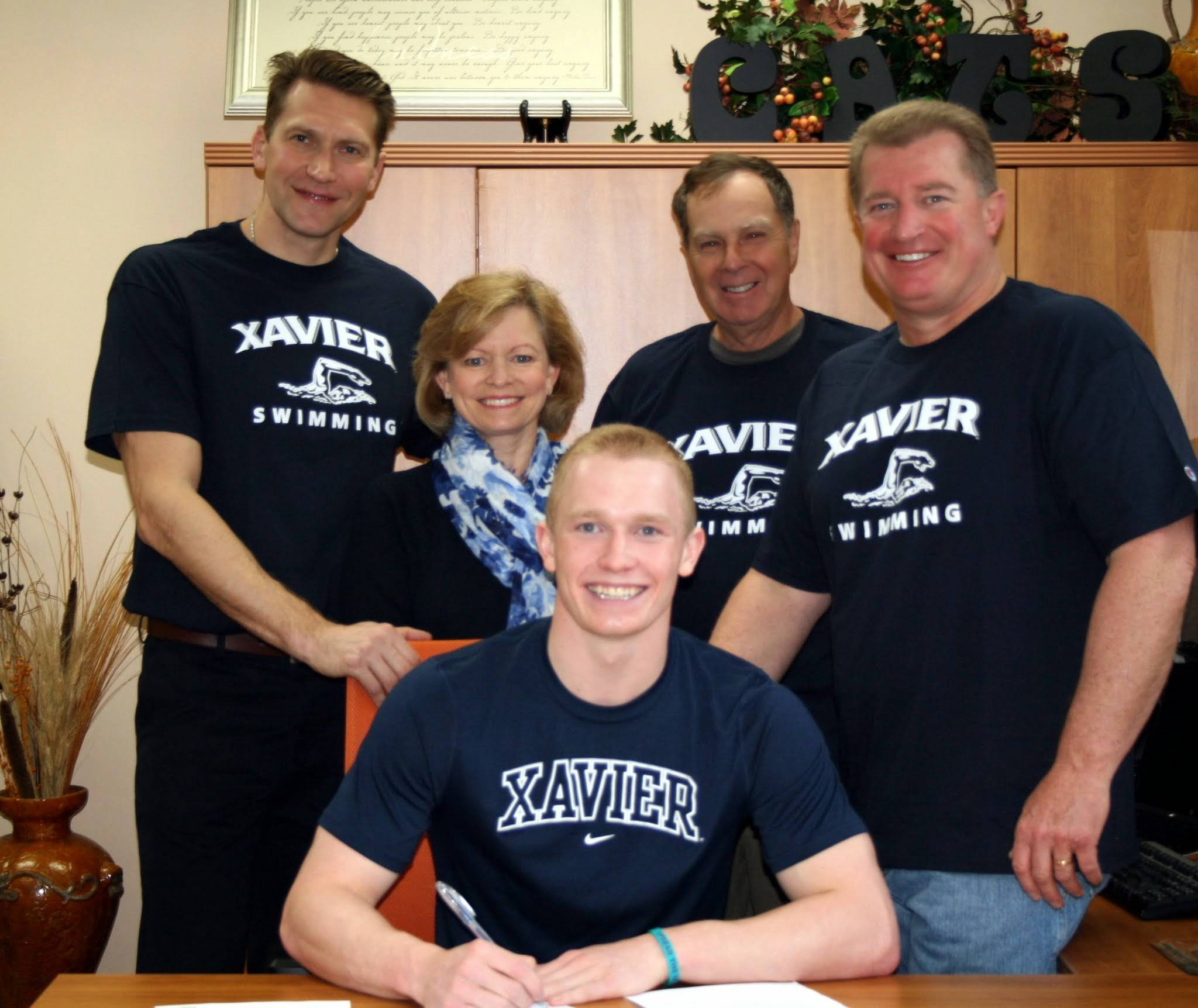 Bobby Snader, front, has committed to swim at Xavier University.