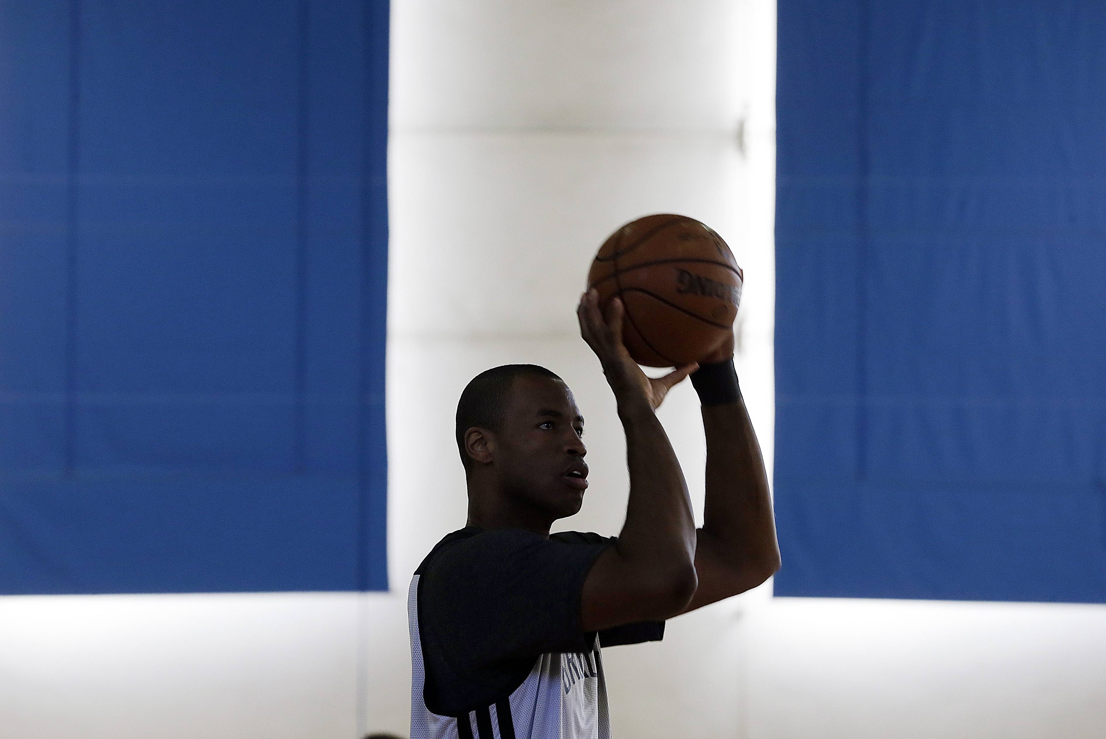 Jason Collins shoots during practice on the UCLA campus in Los Angeles. Collins became the first openly gay active athlete in North America's four major professional sports on Feb. 23, 2014, signing with the Brooklyn Nets.