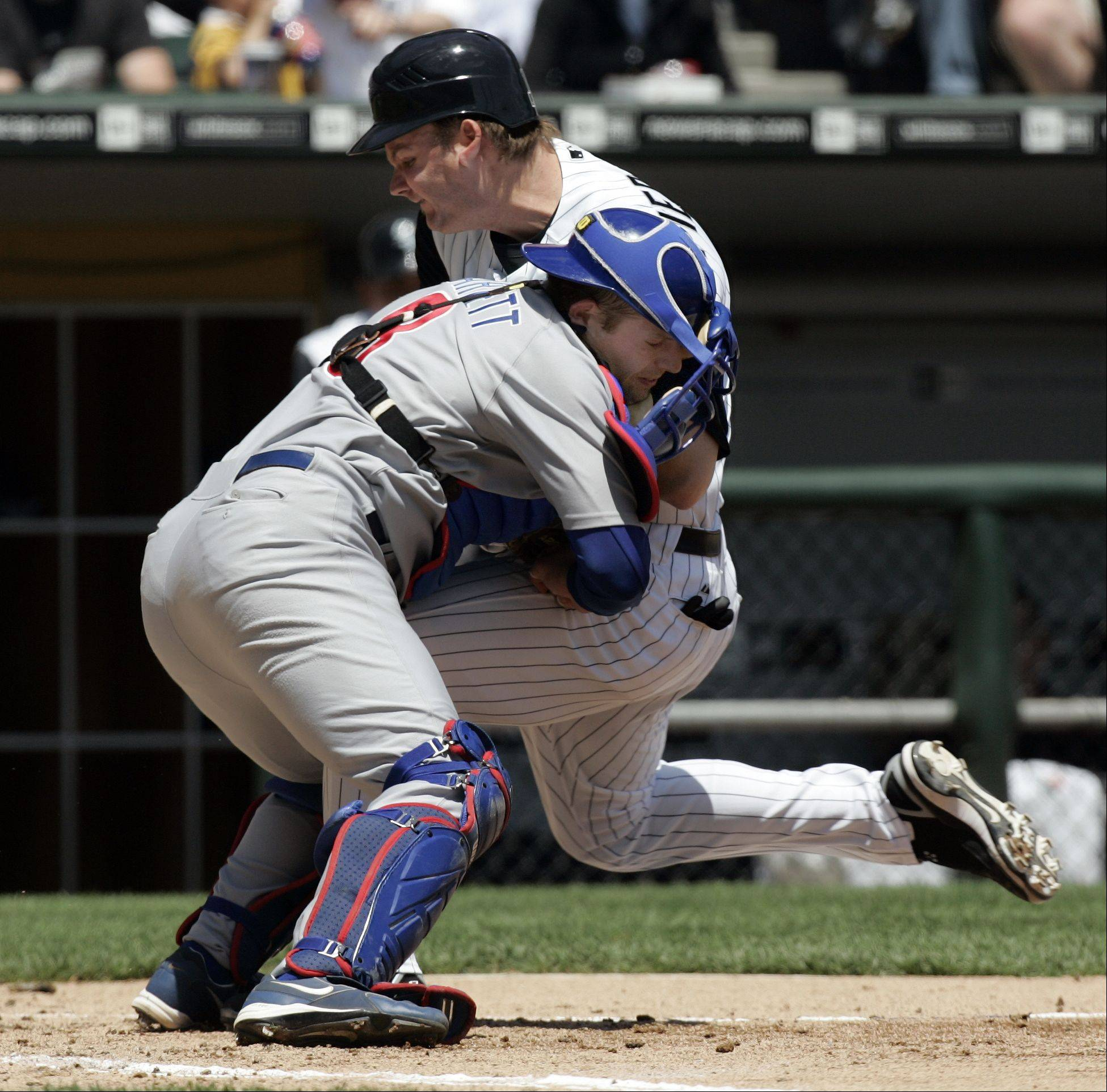 White Sox A.J. Pierzynski collides with Cubs catcher Michael Barrett in the 2nd inning, Game Two Chicago White Sox Vs Chicago Cubs at U.S. Cellular Field in Chicago. May 20, 2006.