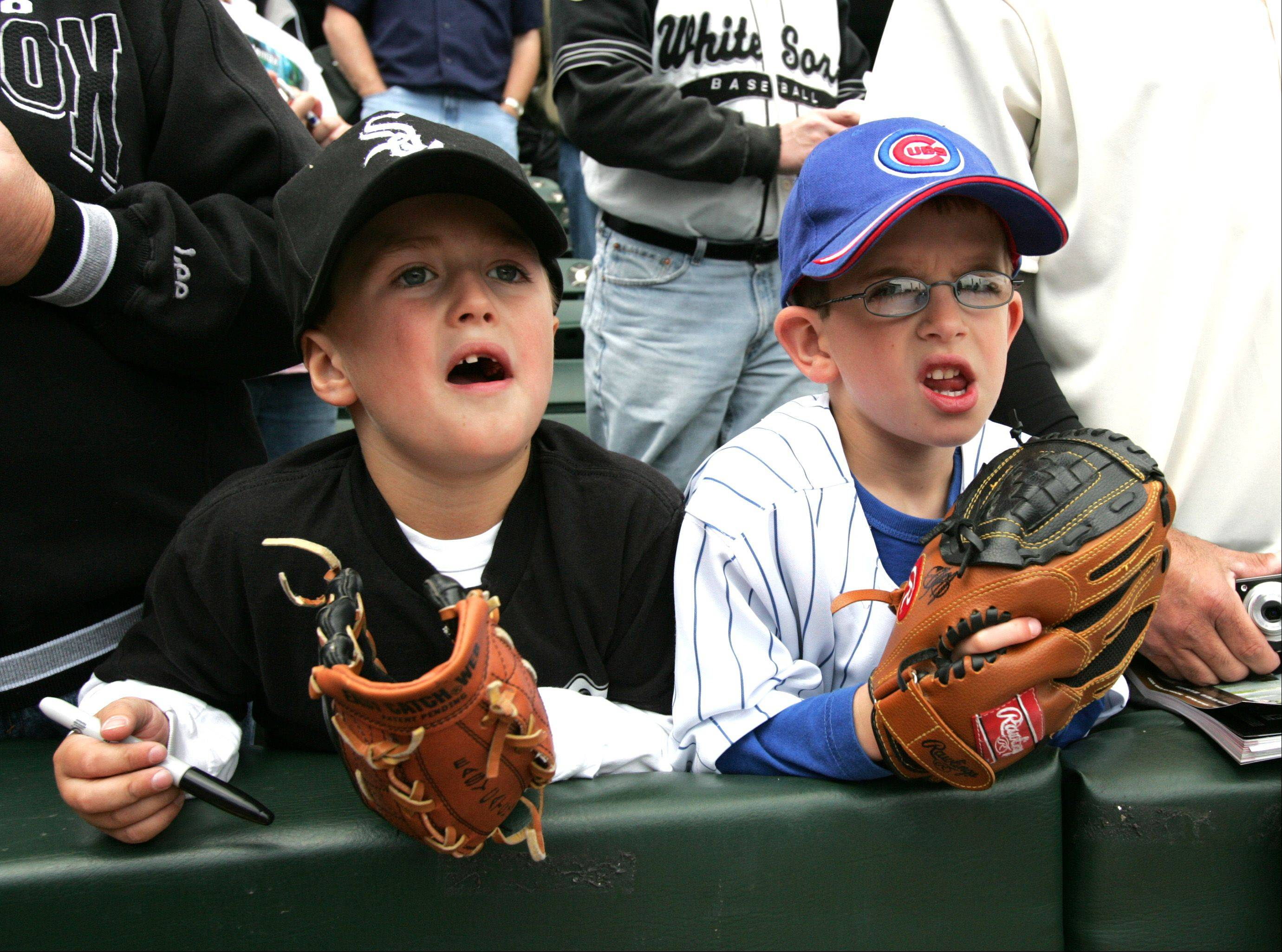 Best of friends Joey Pepper, left and Erik Larson, right, both of South Elgin hunt for autographs as the Chicago Cubs battle the White Sox during the Crosstown Classic at U.S. Cellular Field, Friday.