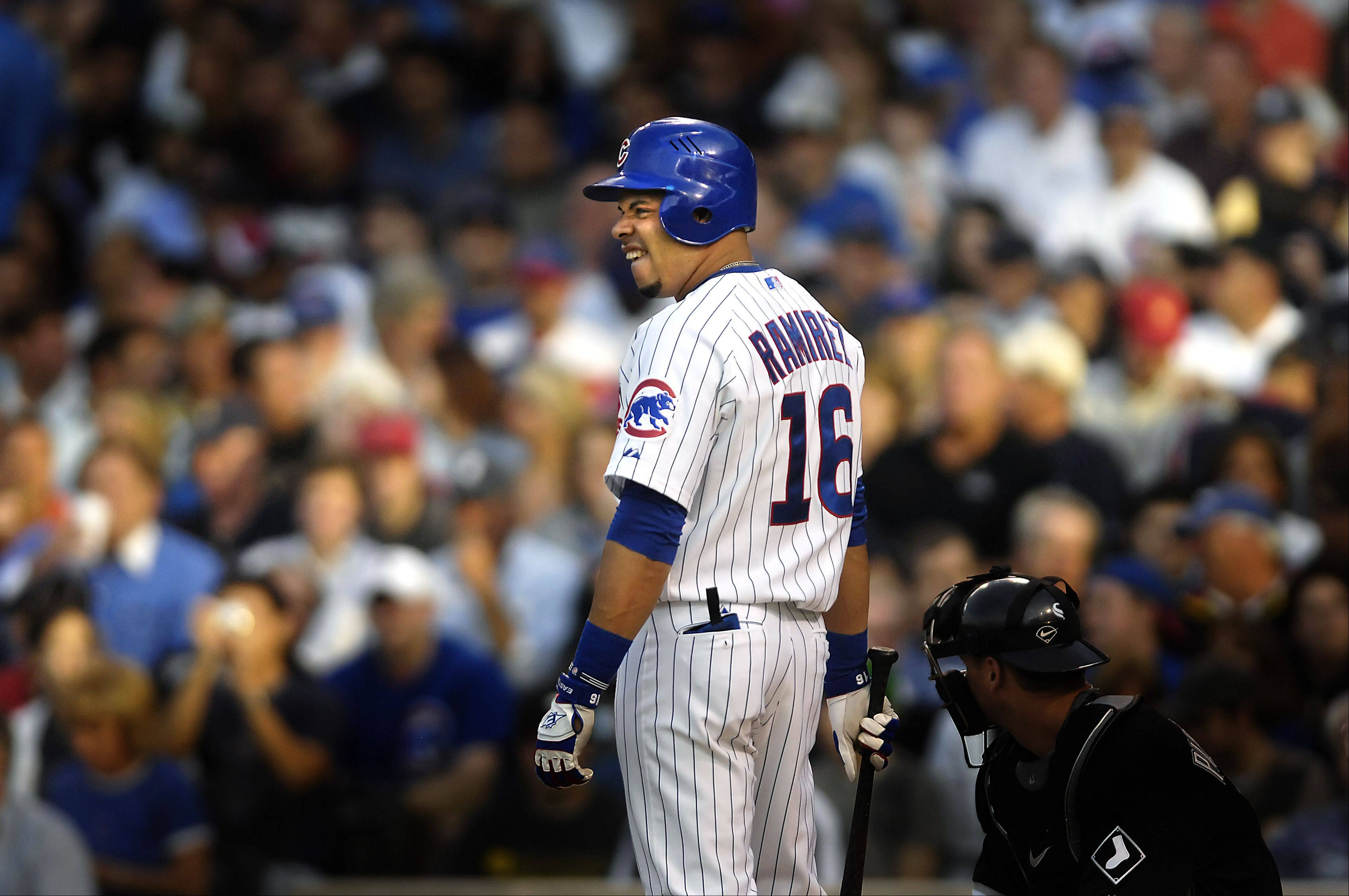 A streak of sunlight splashes the Wrigley Field crowd and Chicago Cubs slugger Aramis Ramirez seems to growl at the mound as he comes to the batters box against the Chicago White Sox at Wrigley Field in 2008.