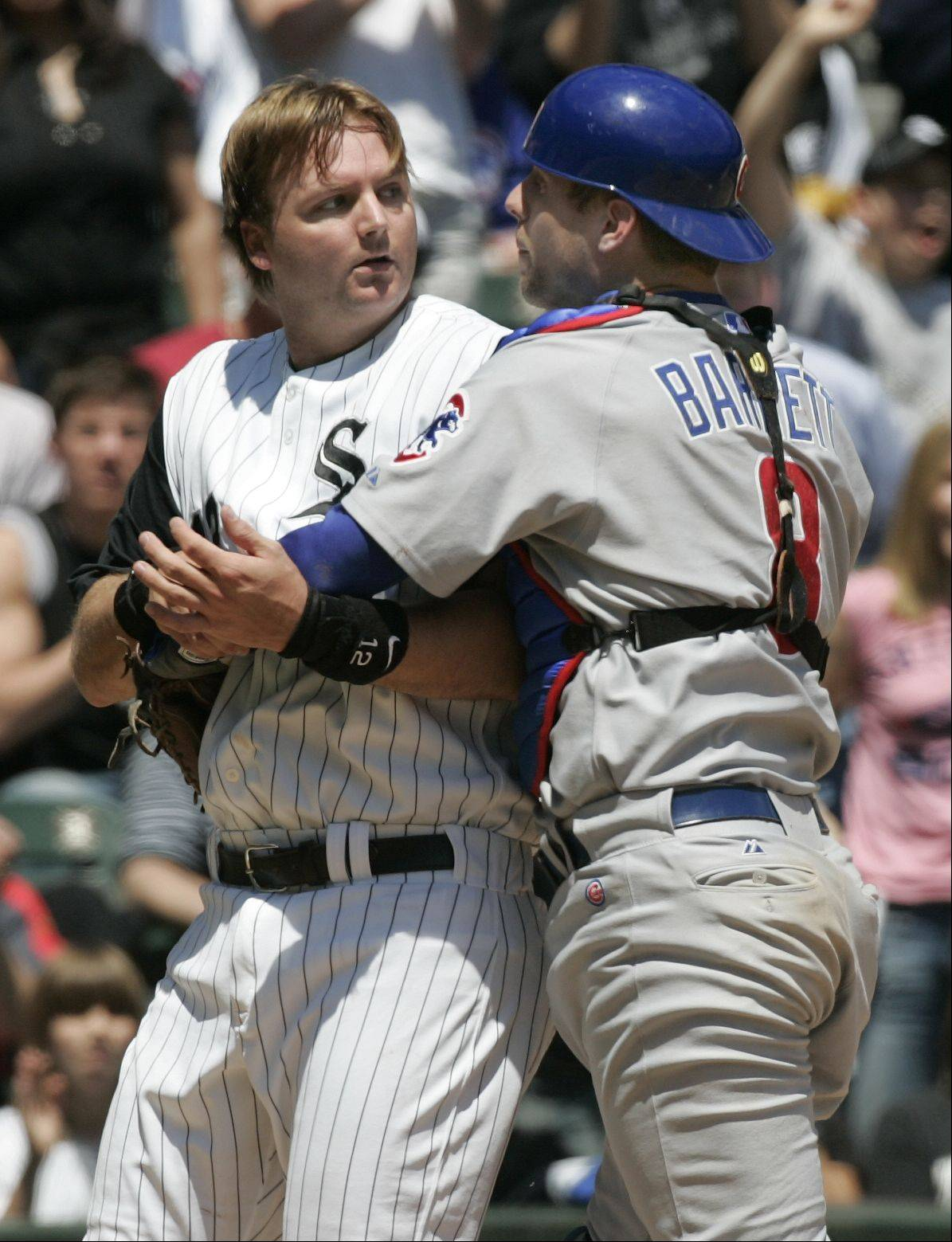 Sox A.J. Pierzynski is grabbed by Cubs Catcher Michael Barrett in the 2nd inning, starting the fight, Game Two Chicago White Sox Vs Chicago Cubs at U.S. Cellular Field in Chicago. May 20, 2006.