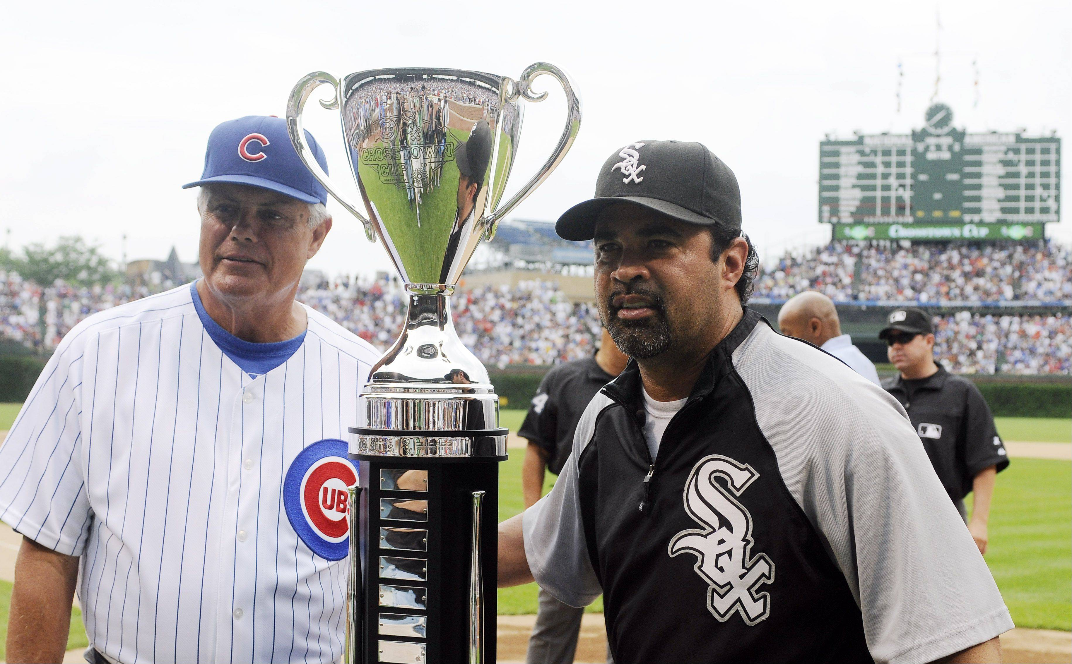 Chicago Cubs manager Lou Piniella and Chicago White Sox manager Ozzie Guillen pose with the BP Cup before a interleague baseball game Friday, June 11, 2010, at Wrigley Field in Chicago.