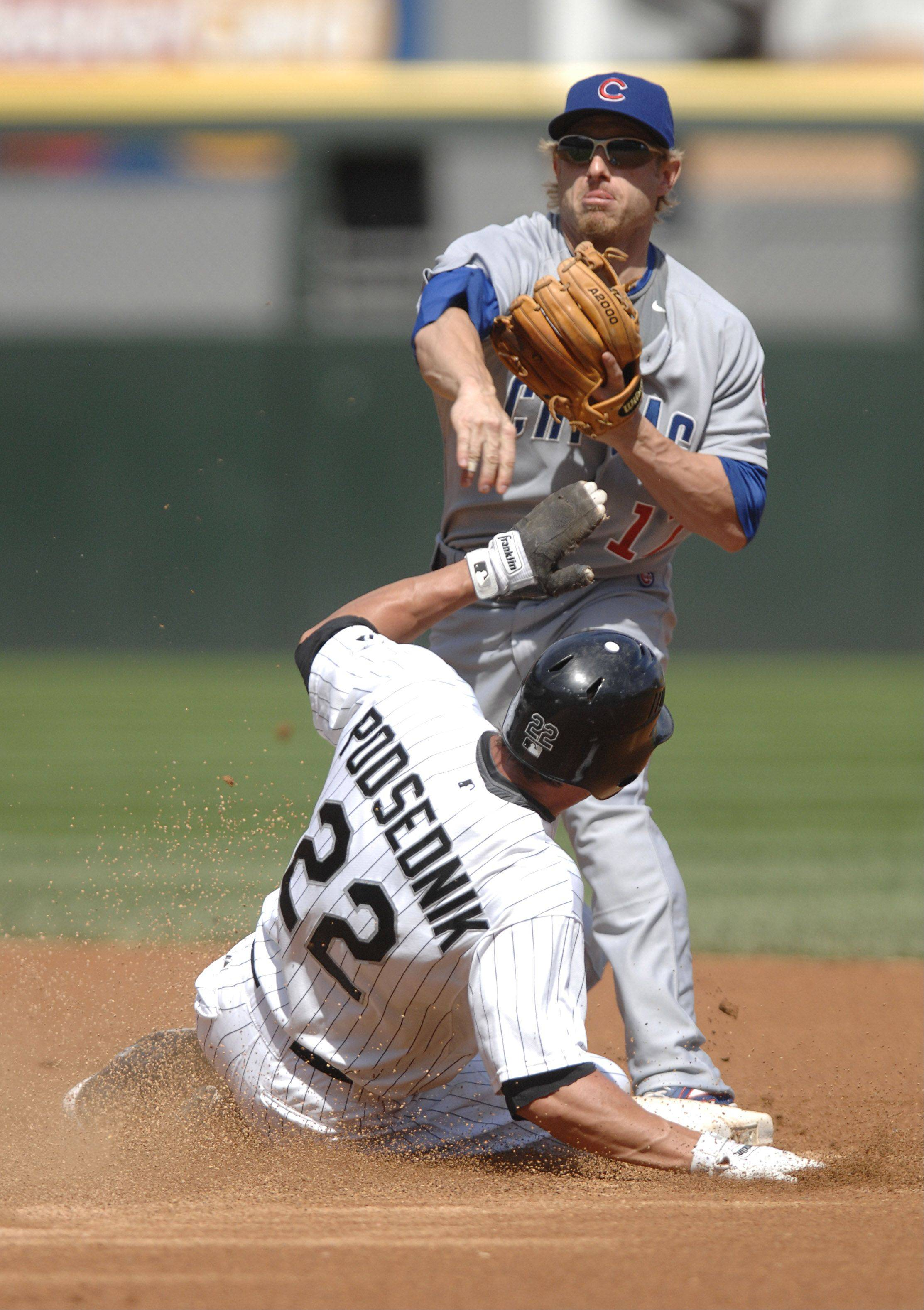 White Sox's Scott Podsednik slides into second and Chicago Cubs secondbaseman Mike Fontenot in the first inning of the Crosstown Classic at U.S. Cellular Field on Friday, June 26 in 2009.