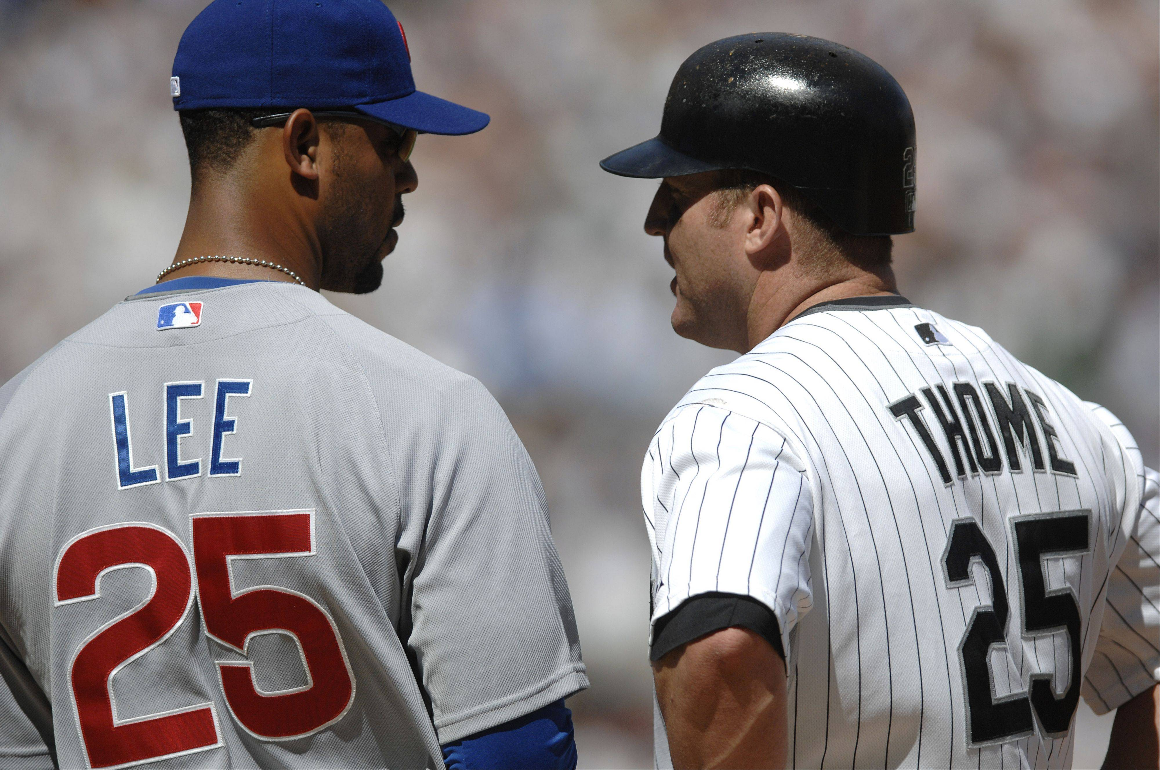 Cubs first baseman Derrek Lee chats with the White Sox's Jim Thome during the first inning of the Crosstown Classic at U.S. Cellular Field on Friday, June 26.