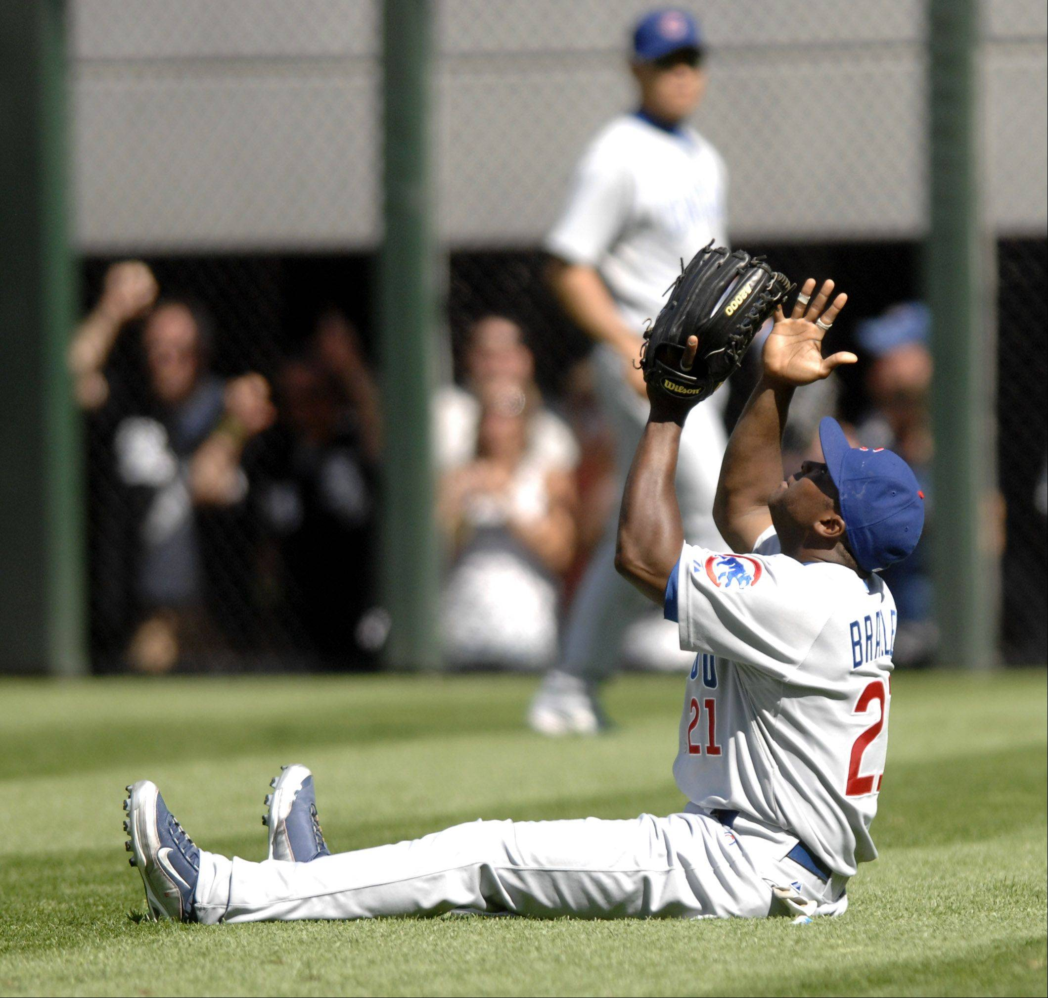 Chicago Cubs' Milton Bradley give thanks above after catching a fly for an out in the fifth inning of Crosstown Classic at U.S. Cellular Field on Friday, June 26.