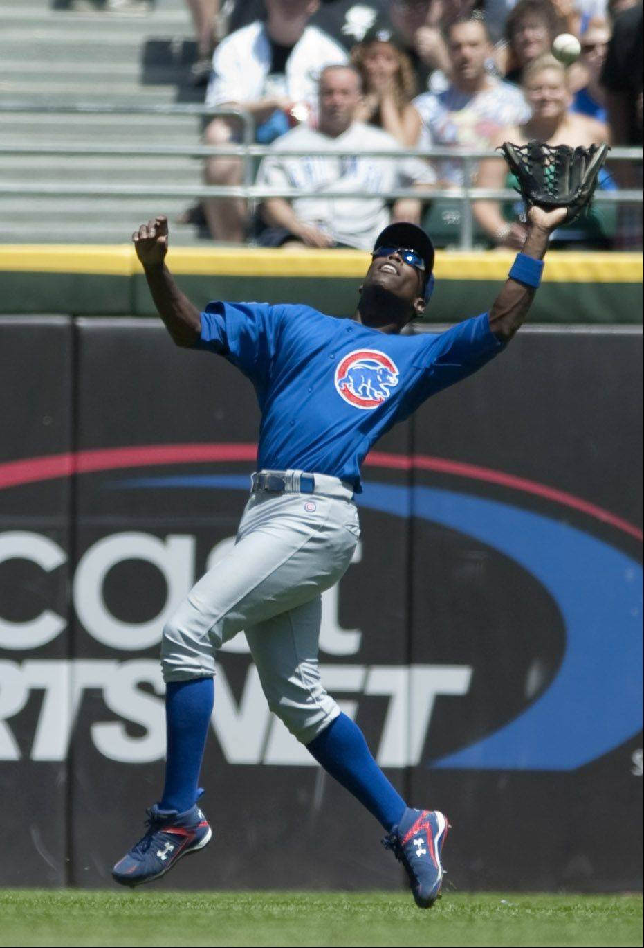 Cubs left fielder Alfonso Soriano catches a flyball during the third inning against the Sox at U.S. Cellular Field on Sunday in Chicago.