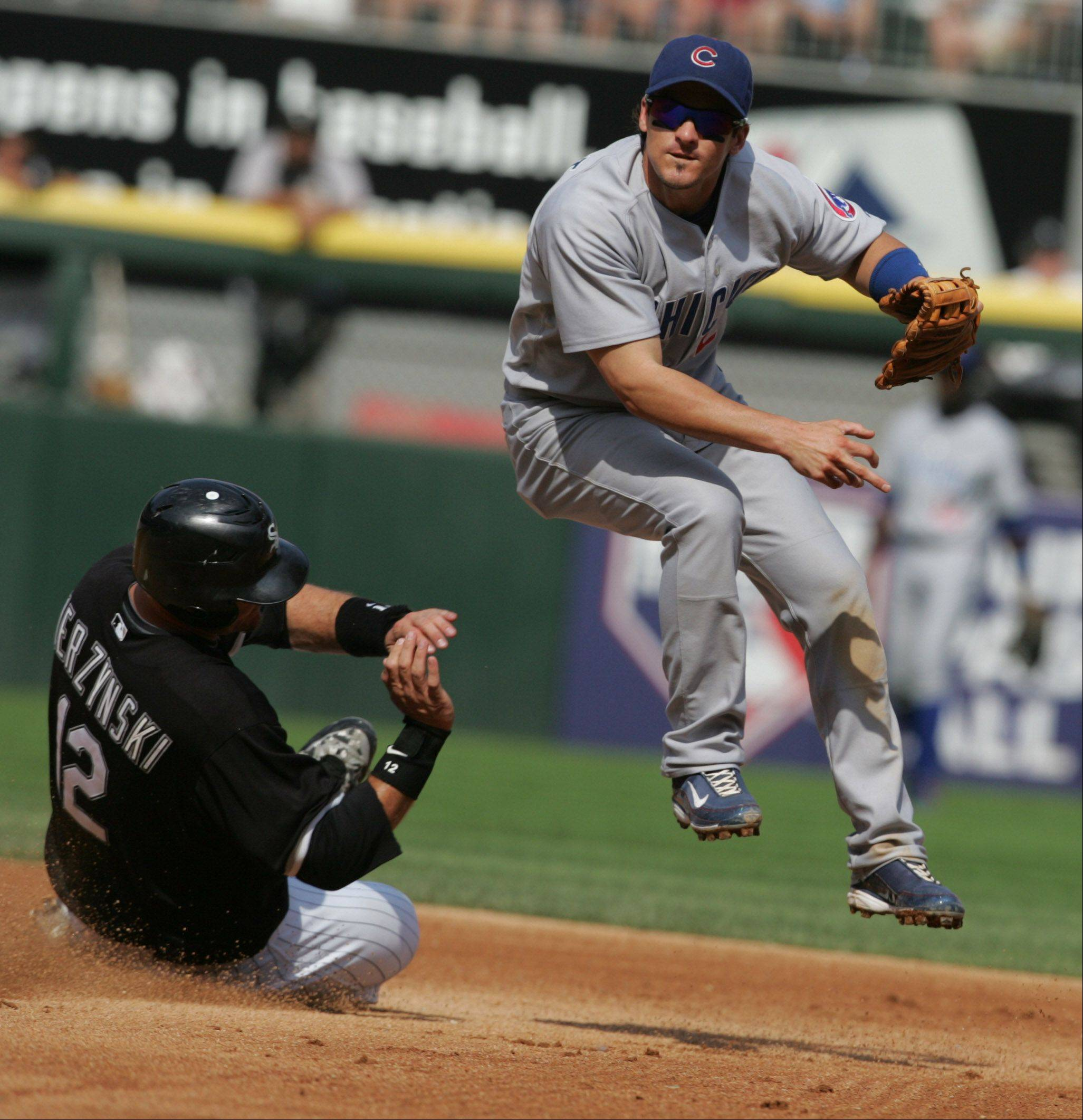 Cubs Ryan Theriot tries for a double play as Sox A.J. Pierzynski slides into second out on Saturday June 28th.