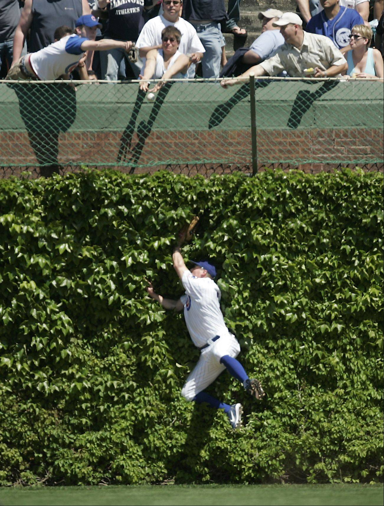 Cubs right fielder Jeromy Burnitz hits the wall as he makes an effort to catch the Sox Tadahito Iguchi HR during the final game of the Cubs vs White Sox series at Wrigley Field.