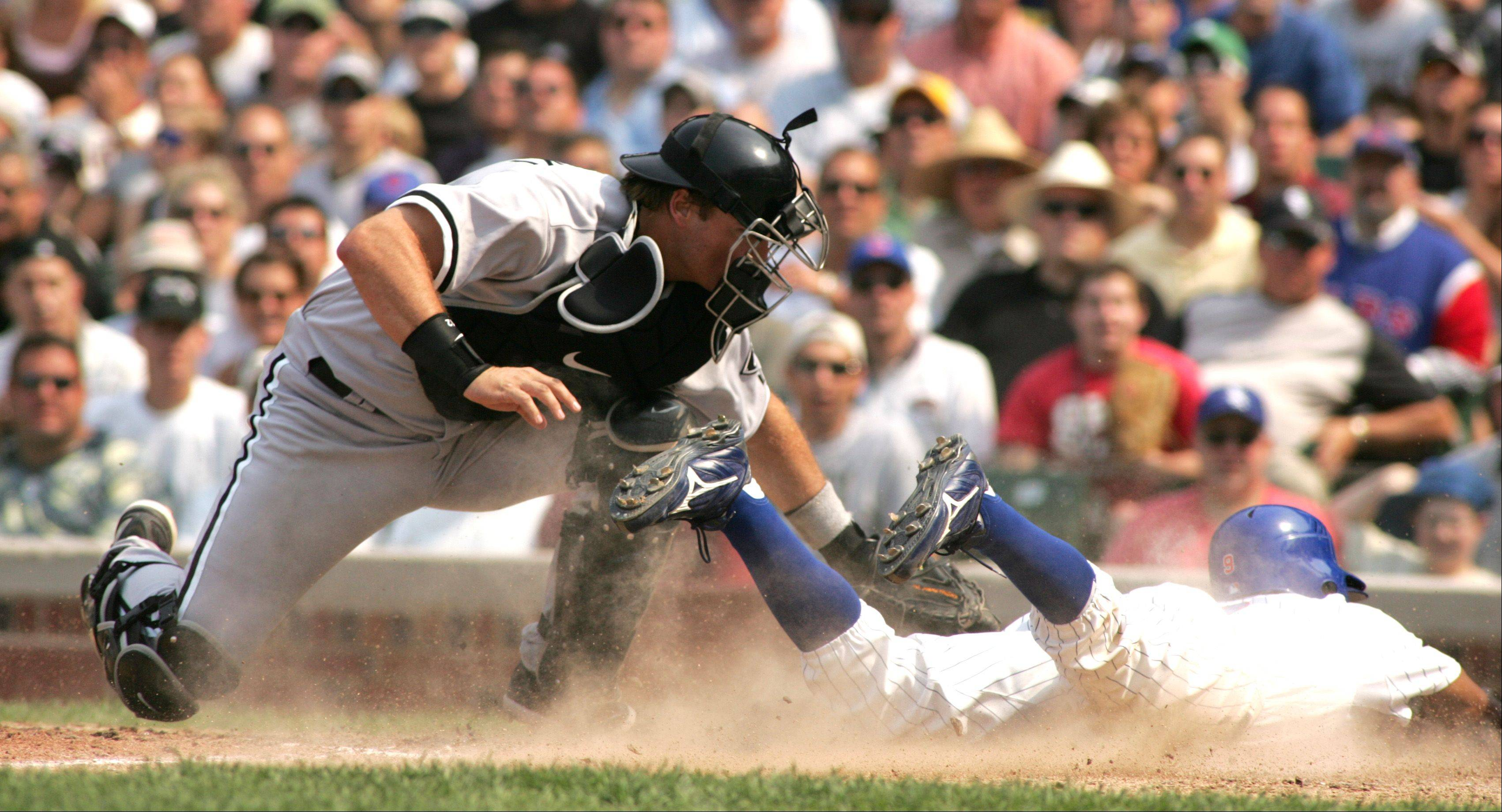 The Sox's A.J Pierzynski tags out Juan Pierre during the 7th inning as the Chicago Cubs battle the Chicago White Sox at Wrigley Field, Friday.