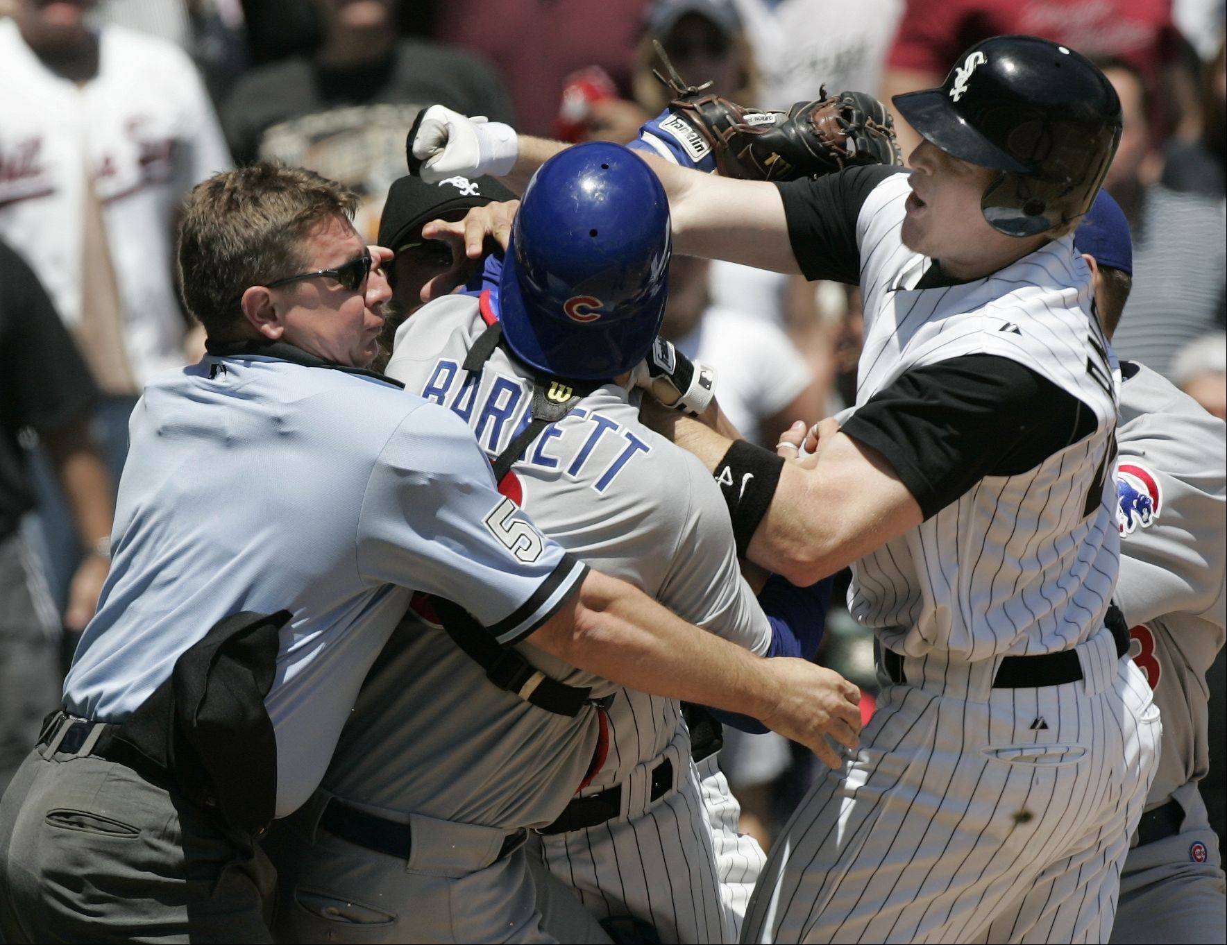 Sox Brian Anderson takes a swing at Cubs catcher Michael Barrett as Home Ump Greg Gibson tries to separate them. Game Two Chicago White Sox Vs Chicago Cubs at U.S. Cellular Field in Chicago. May 20, 2005.