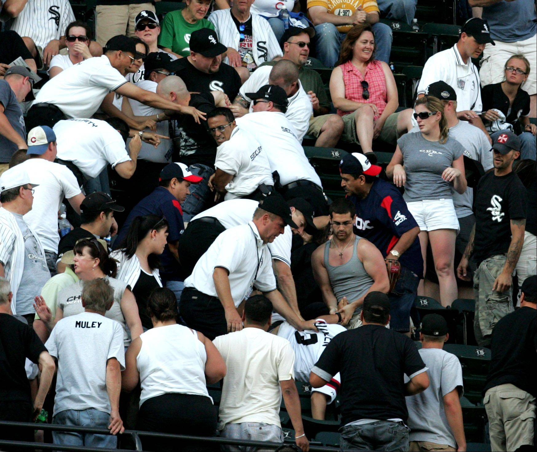 Fans in the stands and security at the Chicago White Sox win 8-7 against Cubs game at U.S. Cellular Field on Saturday June 27th.
