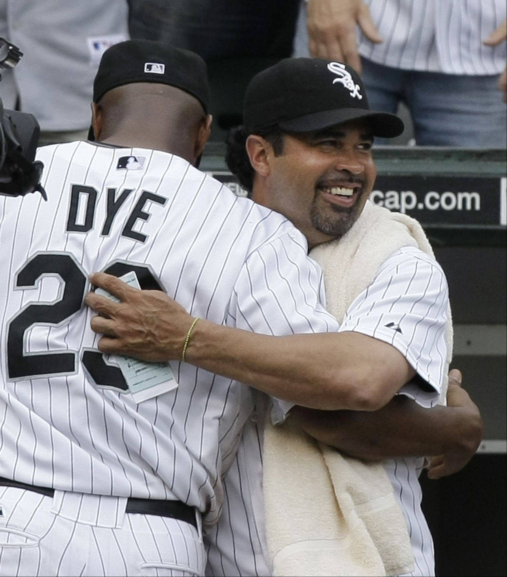 Chicago White Sox manager Ozzie Guillen, right, hugs right fielder Jermaine Dye after Dye robed Chicago Cubs designated hitter Kosuke Fukudome of a two-run home run for the final out of their 10-3 win in Chicago, Friday, June 27, 2008.