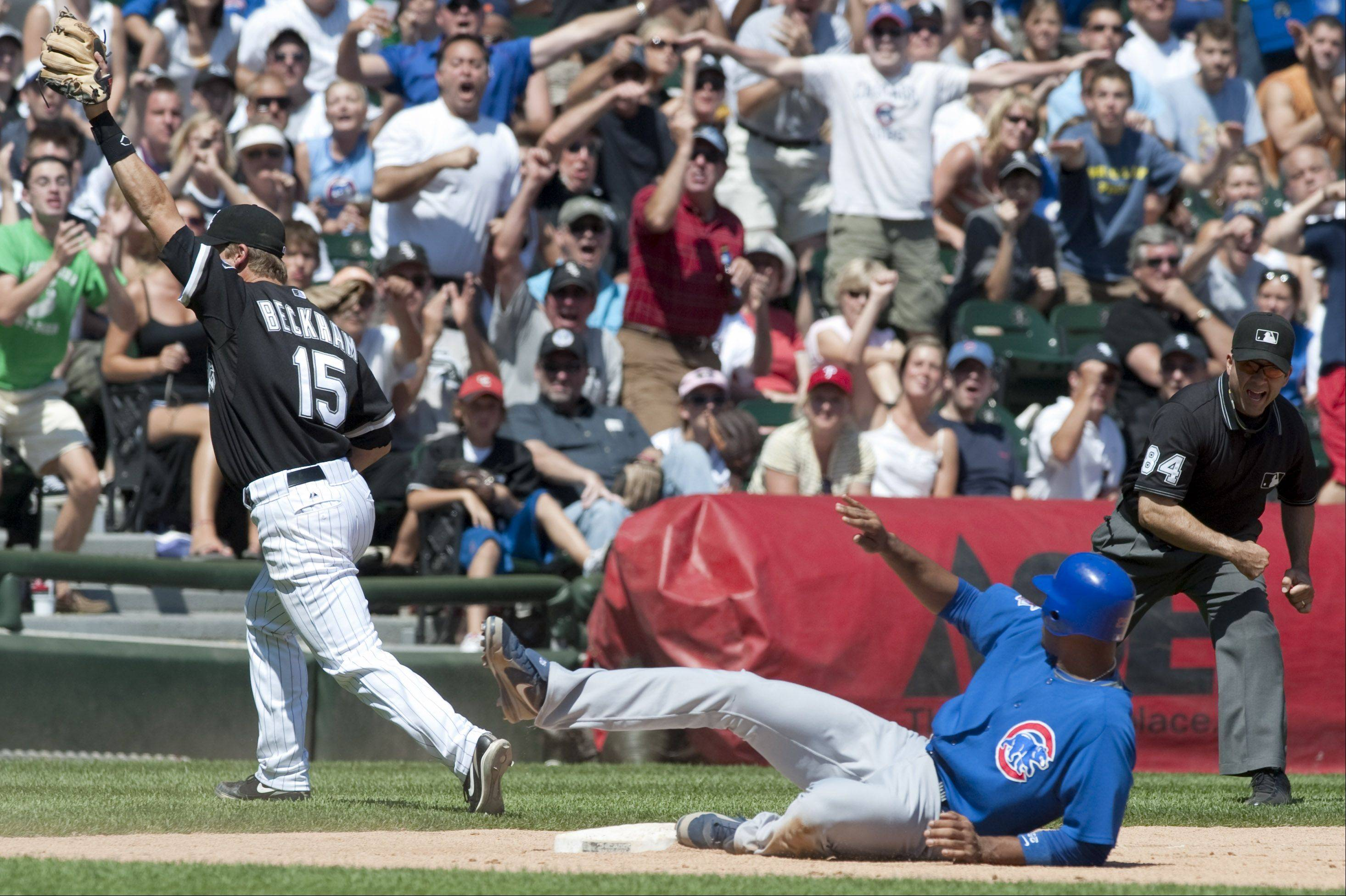 Sox third basemen Gordon Beckham cheers as he forces out Cubs first basemen Derrek Lee at third base during the sixth inning at U.S. Cellular Field on Sunday in Chicago.