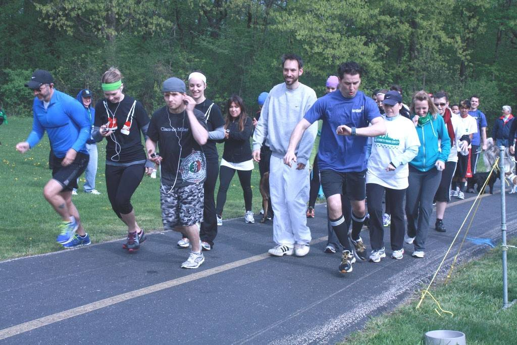 KYC staff members and other participants get ready to hit the running path in the 2013 Kenneth Young Center 5K Run/Walk at Busse Woods.