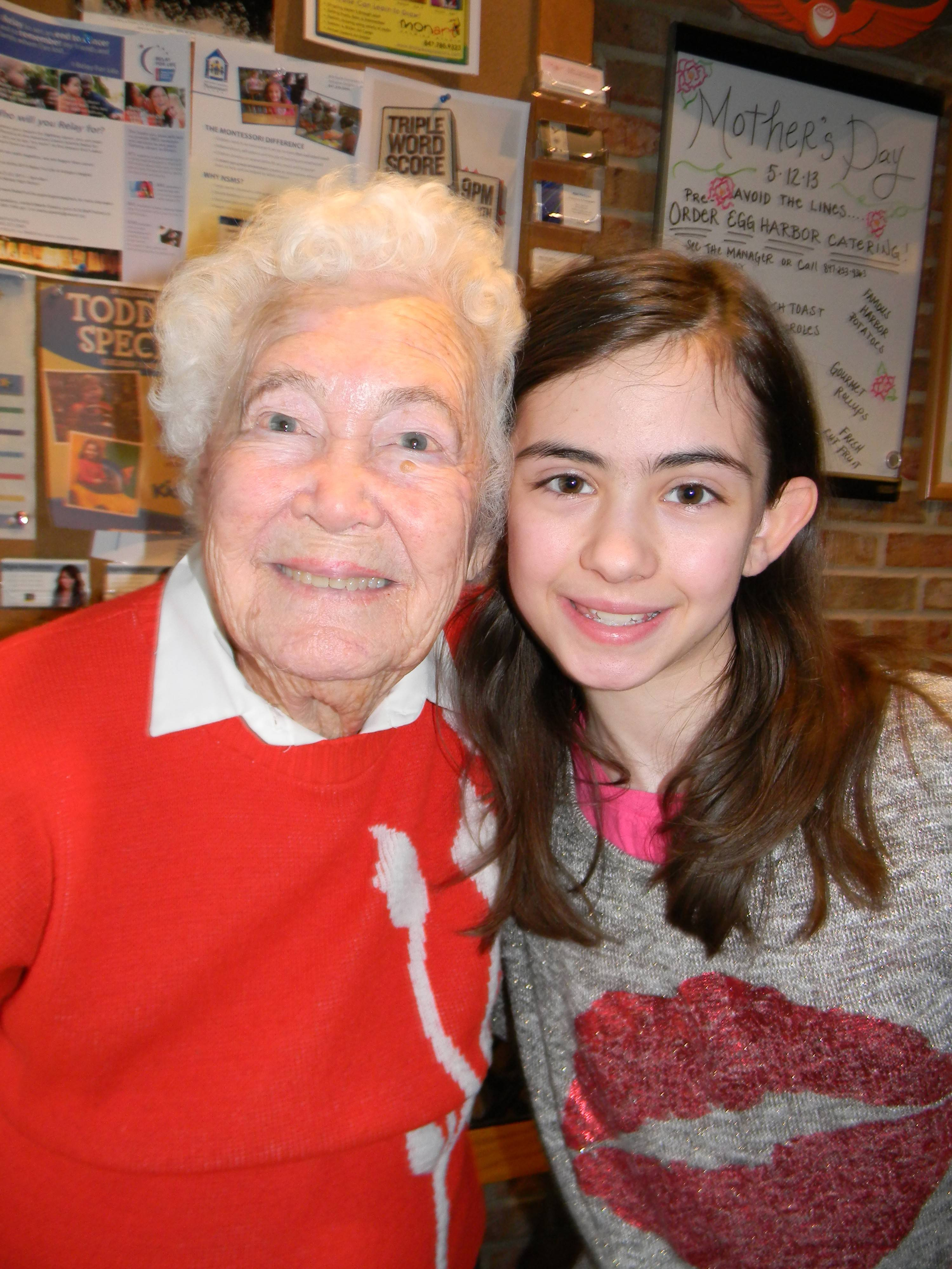 Retired teacher Zanobia Irwin with Margaret Kaden's seventh-grade daughter, Emma.