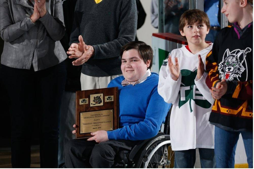 Tim Gruensfelder gets the red carpet treatment at a Chicago Wolves game Sunday, April 6. Gruensfelder was awarded the Chicago Wolves Tim Breslin Memorial Scholarship, which recognizes a high school senior who has overcome great adversity.
