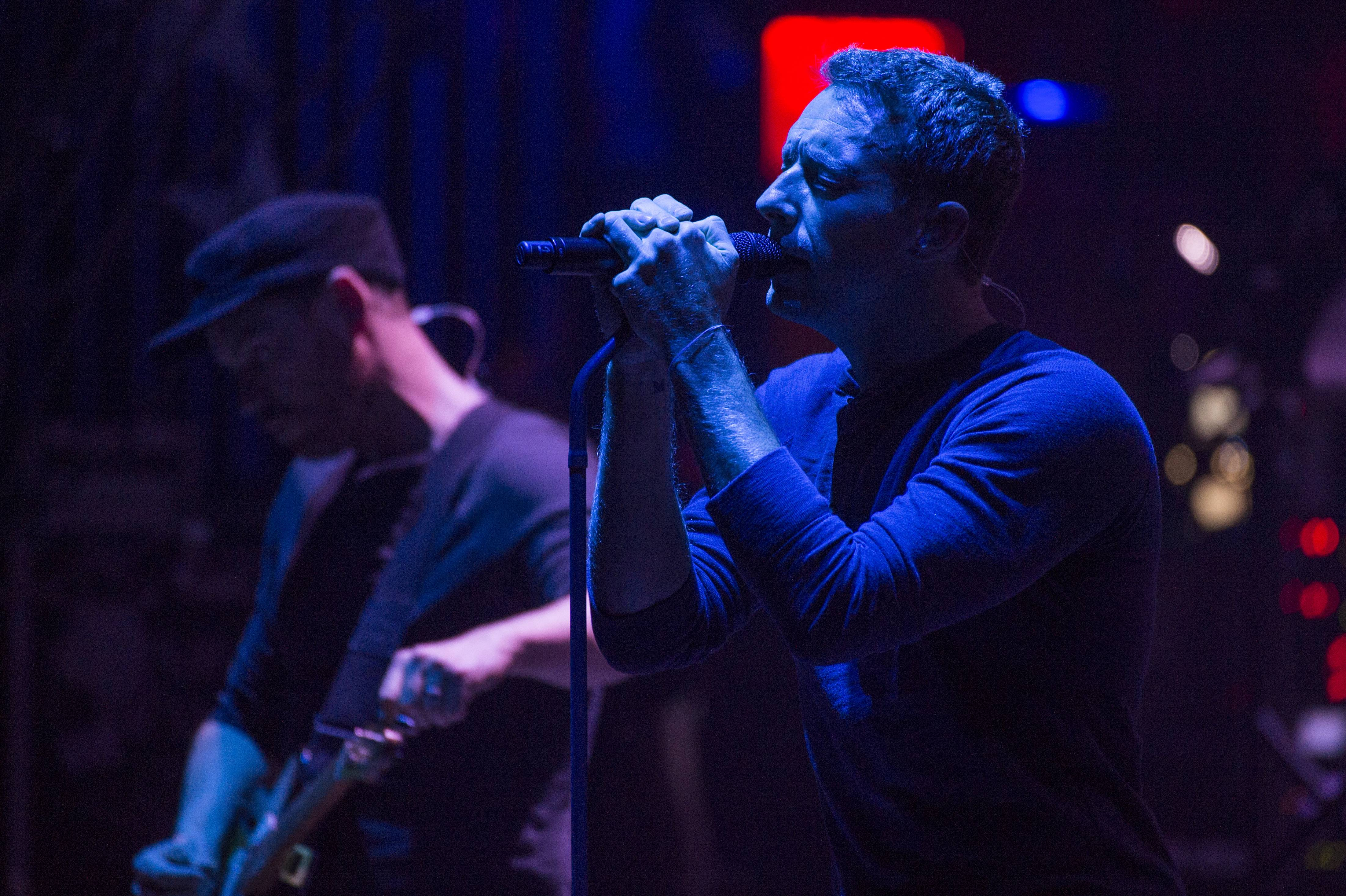 Chris Martin, right, and Jonny Buckland from the band Coldplay perform at the Beacon Theatre on Monday, May 5, 2014, in New York.