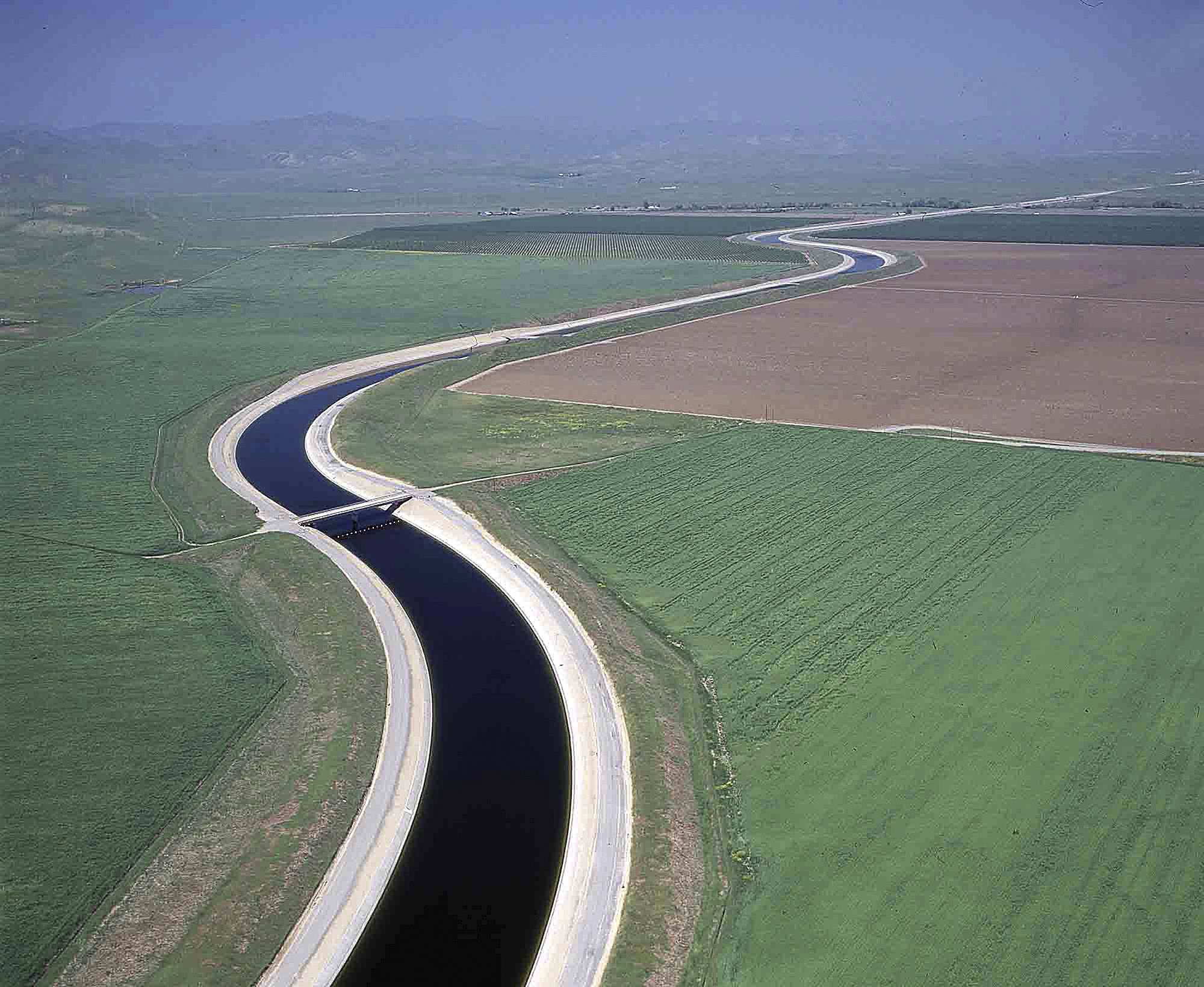 Water makes its way south through the Central Valley by way of the California Aqueduct. The California Aqueduct has been ferrying water from the state's verdant north to the south's arid croplands and cities since Gov. Jerry Brown's father was in office half a century ago. But now, amid one of the worst droughts on record, a group of farmers want to route some of that water back uphill.