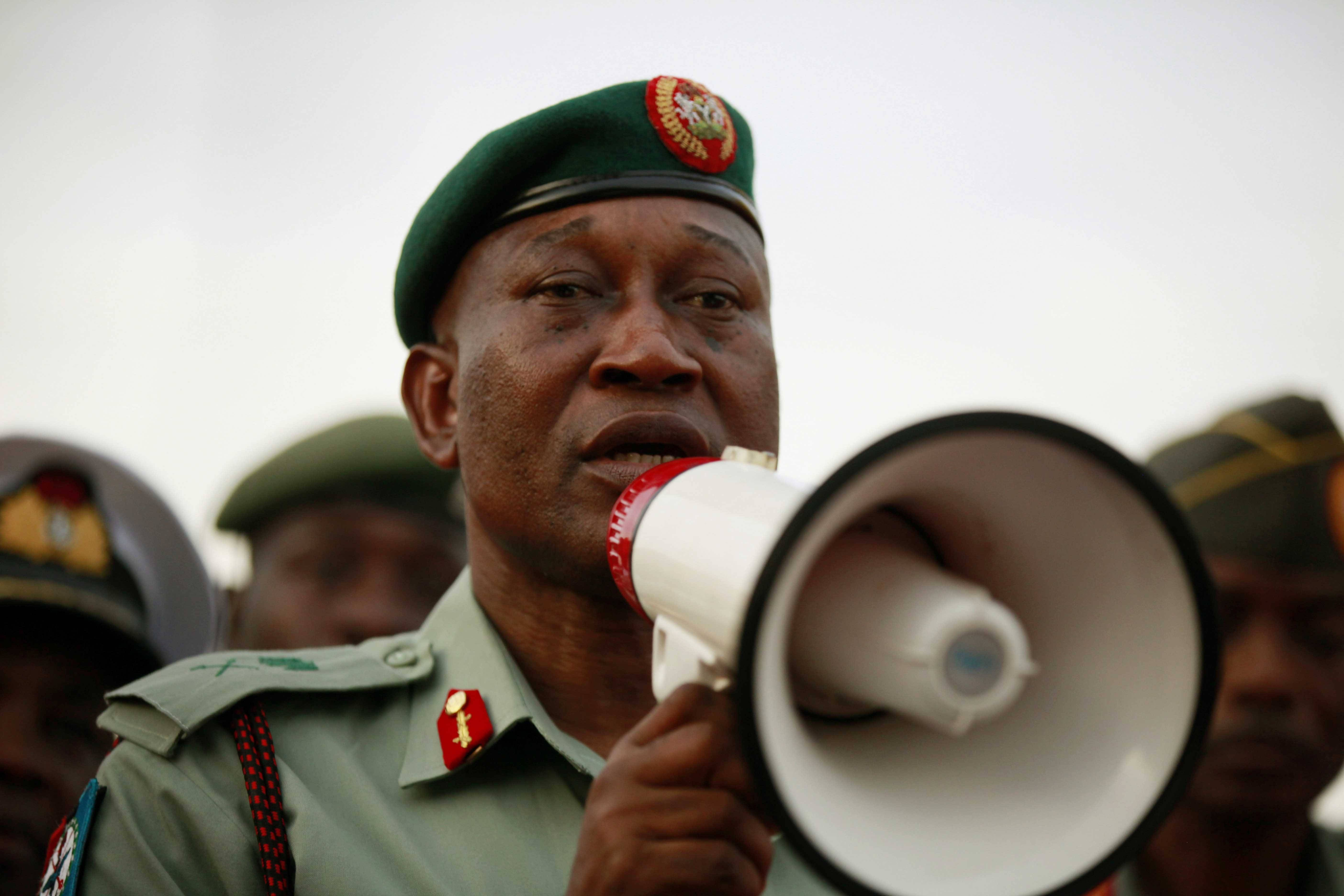Brig. Gen. Chris Olukolade, Nigeria's top military spokesman, speaks to people at a demonstration calling on the government to rescue the kidnapped school girls from the Chibok government secondary school, outside the defense headquarters, in Abuja, Nigeria, Tuesday.