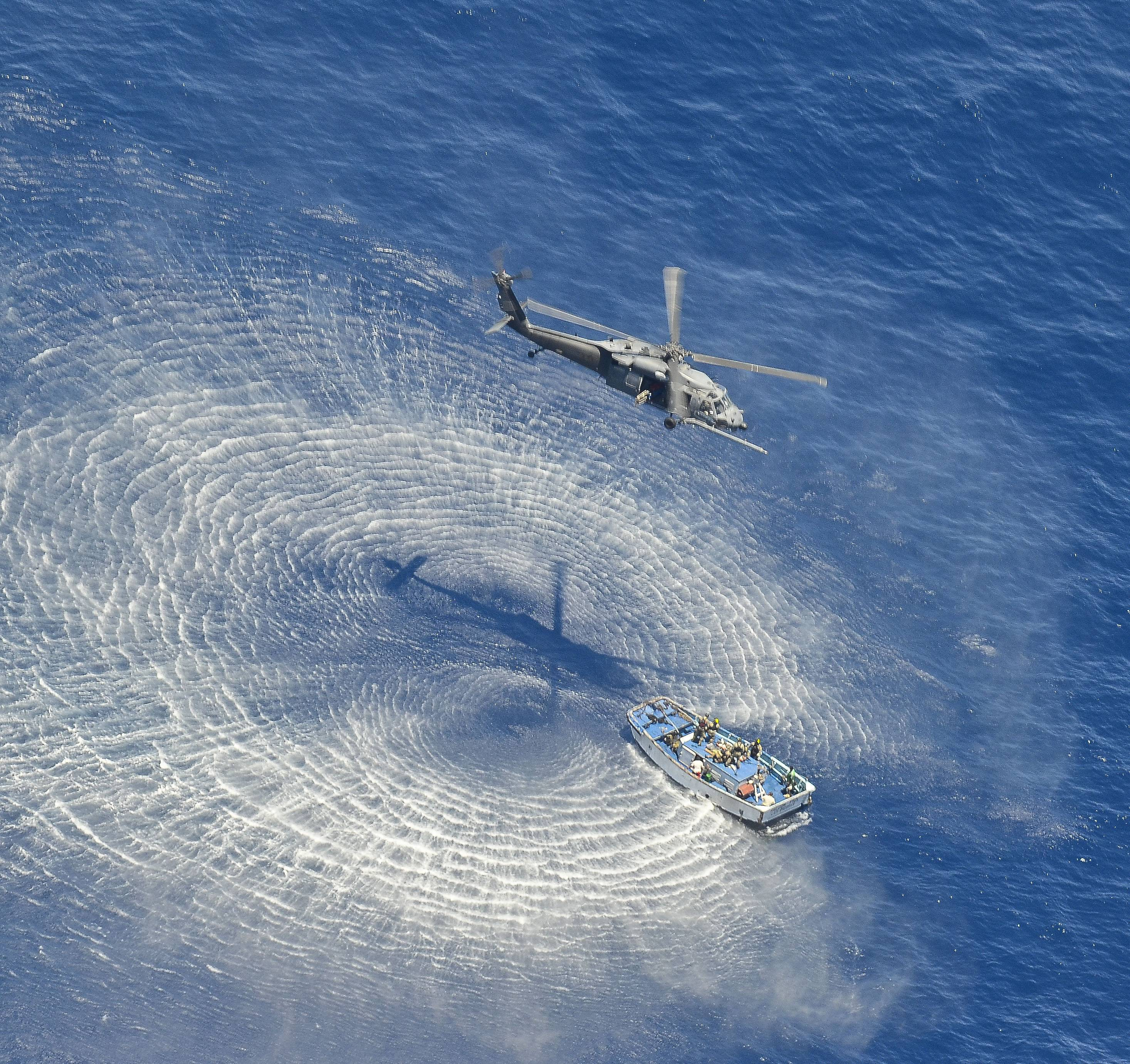 A U.S. Air Force HH-60G Pavehawk helicopter from the 55th Rescue Squadron hovers 600 nautical miles off the Pacific Coast of Mexico to hoist two badly burned Chinese fishermen. The two were among 17 Chinese crew members believed aboard a fishing vessel that caught fire and sank in the Pacific Ocean.