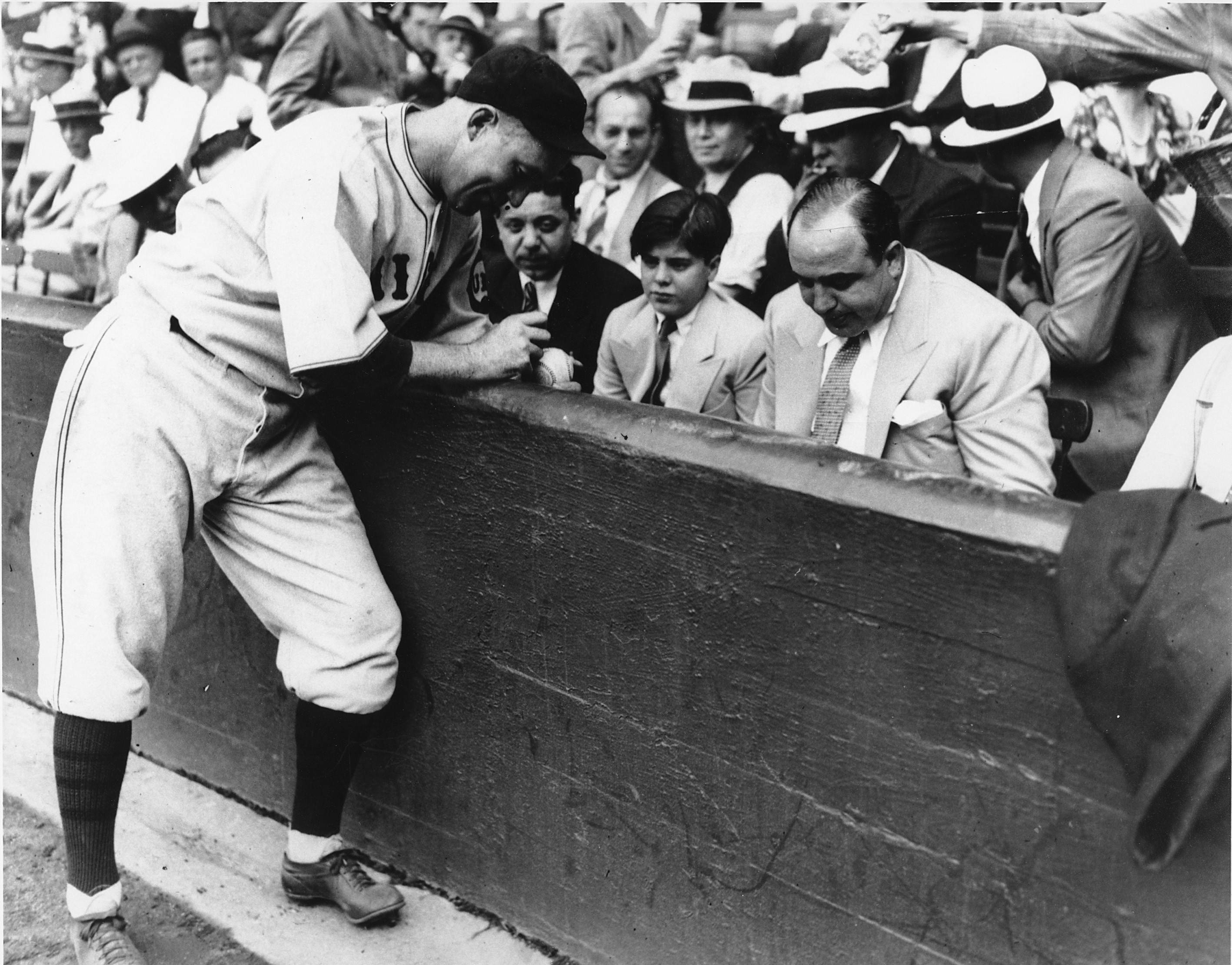Cubs fan and mobster Al Capone gets an autograph from legendary Cubs catcher Gabby Hartnett during a 1931 charity game between the Cubs and White Sox at Comiskey Park. If Capone had made good on his dream to buy the Cubs, he would have tried to integrate baseball in the 1930s.
