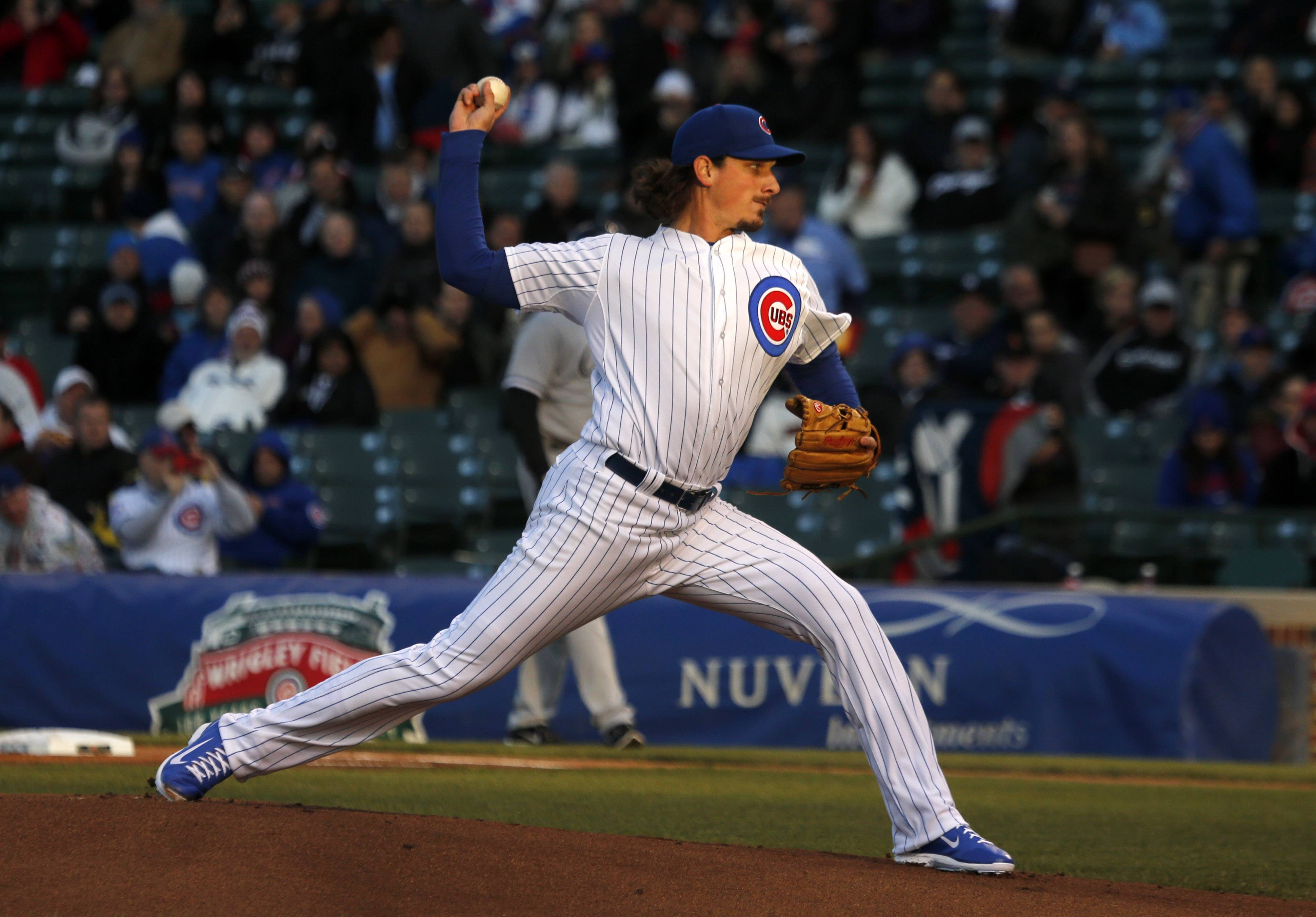 Chicago Cubs starting pitcher Jeff Samardzija delivers in a late setting sun during the first inning of an interleague baseball game against the Chicago White Sox Monday, May 5, 2014, in Chicago. (AP Photo/Charles Rex Arbogast)
