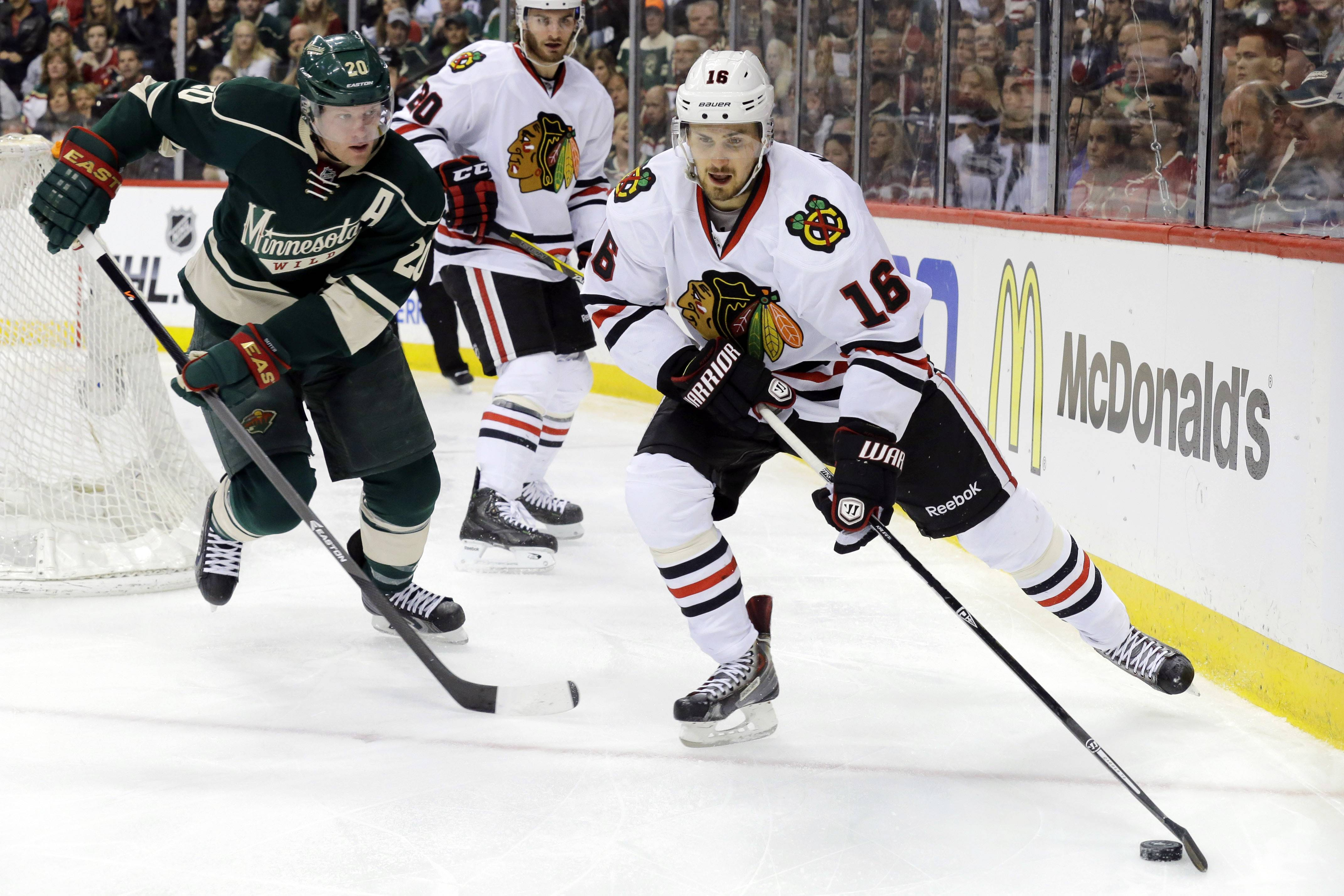 Chicago Blackhawks center Marcus Kruger (16) controls the puck in front of Minnesota Wild defenseman Ryan Suter (20) during the second period.